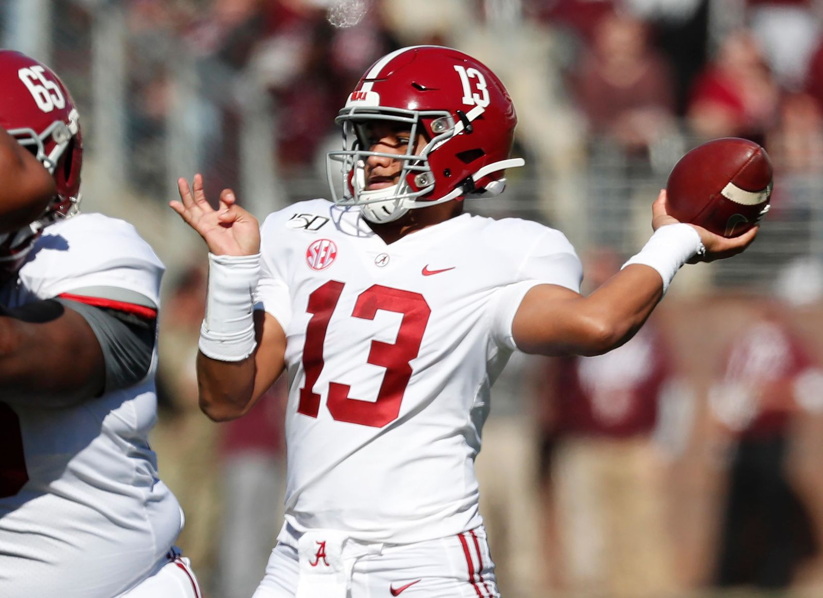 Alabama quarterback Tua Tagovailoa (13) throws a pass against Mississippi State during the first half of an NCAA college football game in Starkville, Miss., Saturday, Nov. 16, 2019. (AP Photo/Rogelio V. Solis)