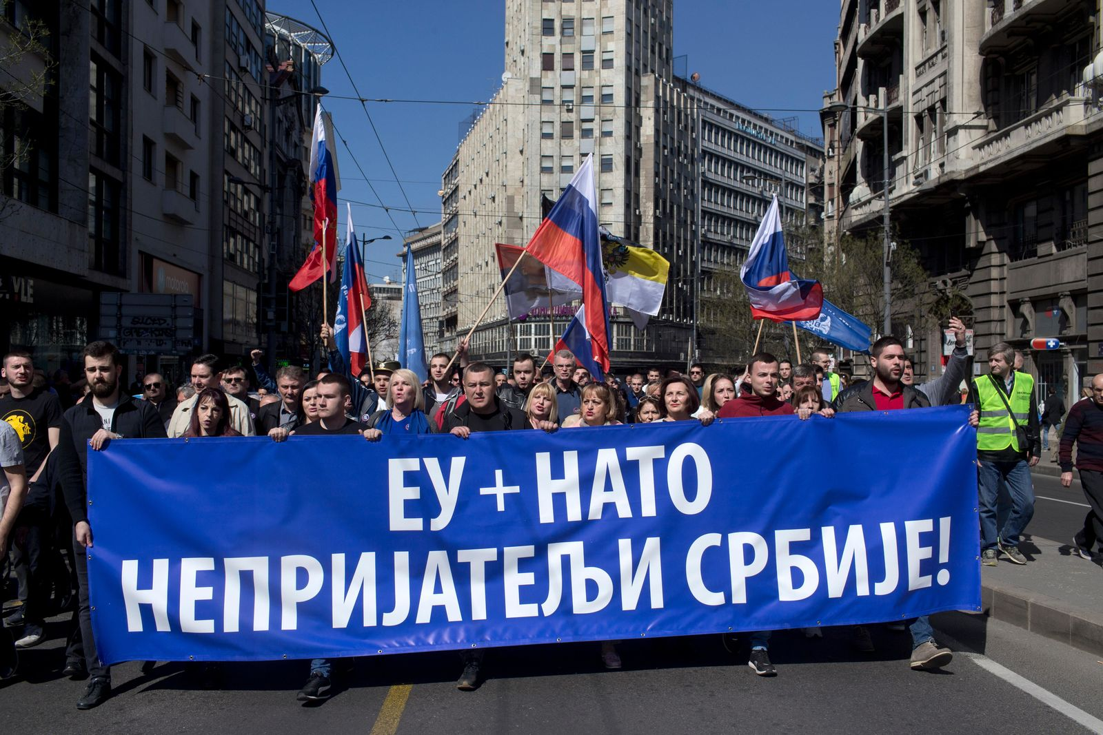 Supporters of the ultranationalist Serbian Radical Party march down a street during a protest in Belgrade, Serbia, Sunday, March 24, 2019. (AP Photo/Marko Drobnjakovic)