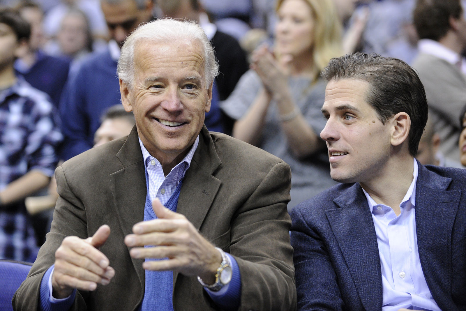 FILE - In this Jan. 30, 2010, file photo, Vice President Joe Biden, left, with his son Hunter, right, at the Duke Georgetown NCAA college basketball game in Washington. (AP Photo/Nick Wass, File)