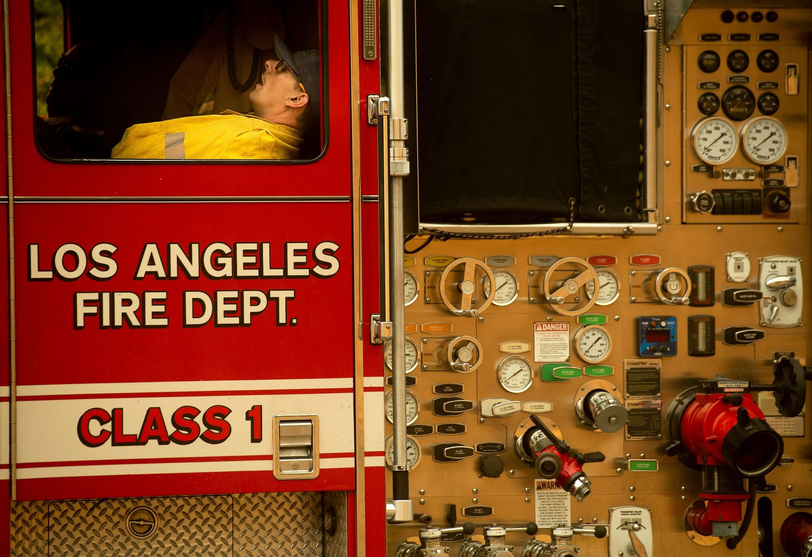 A firefighter rests as crews continue to battle the Saddleridge Fire burning in Porter Ranch, Calif., on Friday, Oct. 11, 2019. (AP Photo/Noah Berger)
