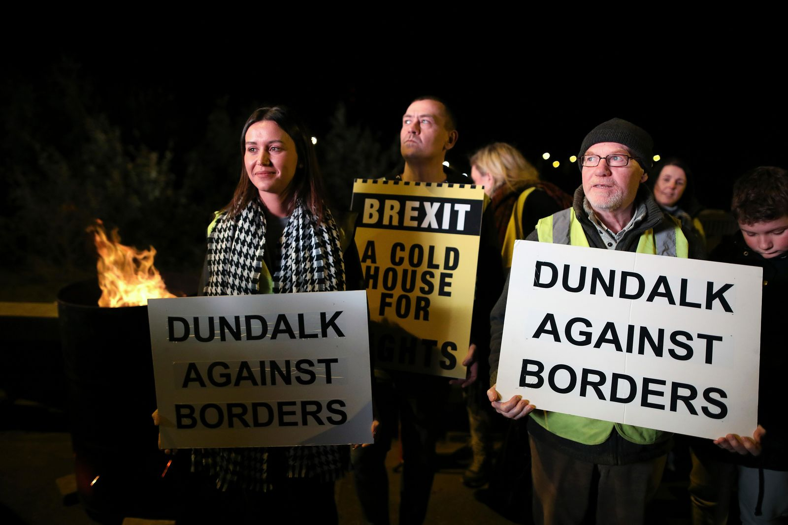 Protesters from the Border Communities Against Brexit group hold a demonstration on the Irish border on the Republic of Ireland side close to the town of Jonesborough, Ireland, Wednesday, Oct. 16 , 2019. (AP Photo/Peter Morrison)