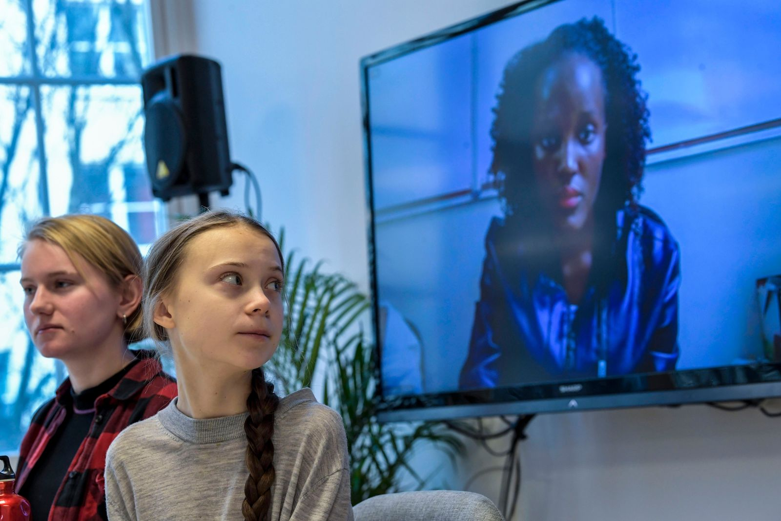 FILE - In this file photo dated Friday Jan. 31, 2020, Ugandan climate activist Vanessa Nakate, right, speaks via video-link as Ell Ottosson Jarl and Greta Thunberg, center, together attend a press conference with climate activists and experts from Africa, in Stockholm, Sweden(Pontus Lundahl/TT FILE  via AP)