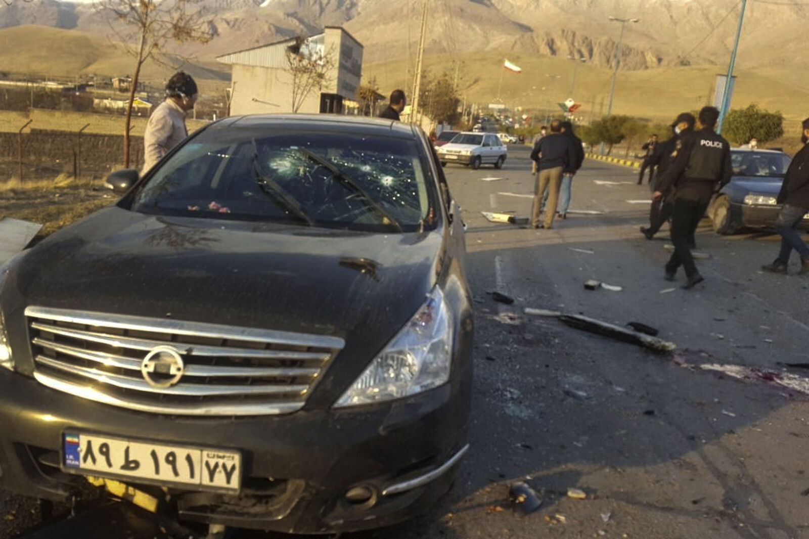 WARNING: THIS PHOTO MAY BE UPSETTING TO SOME VIEWERS. This photo released by the semi-official Fars News Agency shows the scene where Mohsen Fakhrizadeh was killed in Absard, a small city just east of the capital, Tehran, Iran, Friday, Nov. 27, 2020. (Fars News Agency via AP)