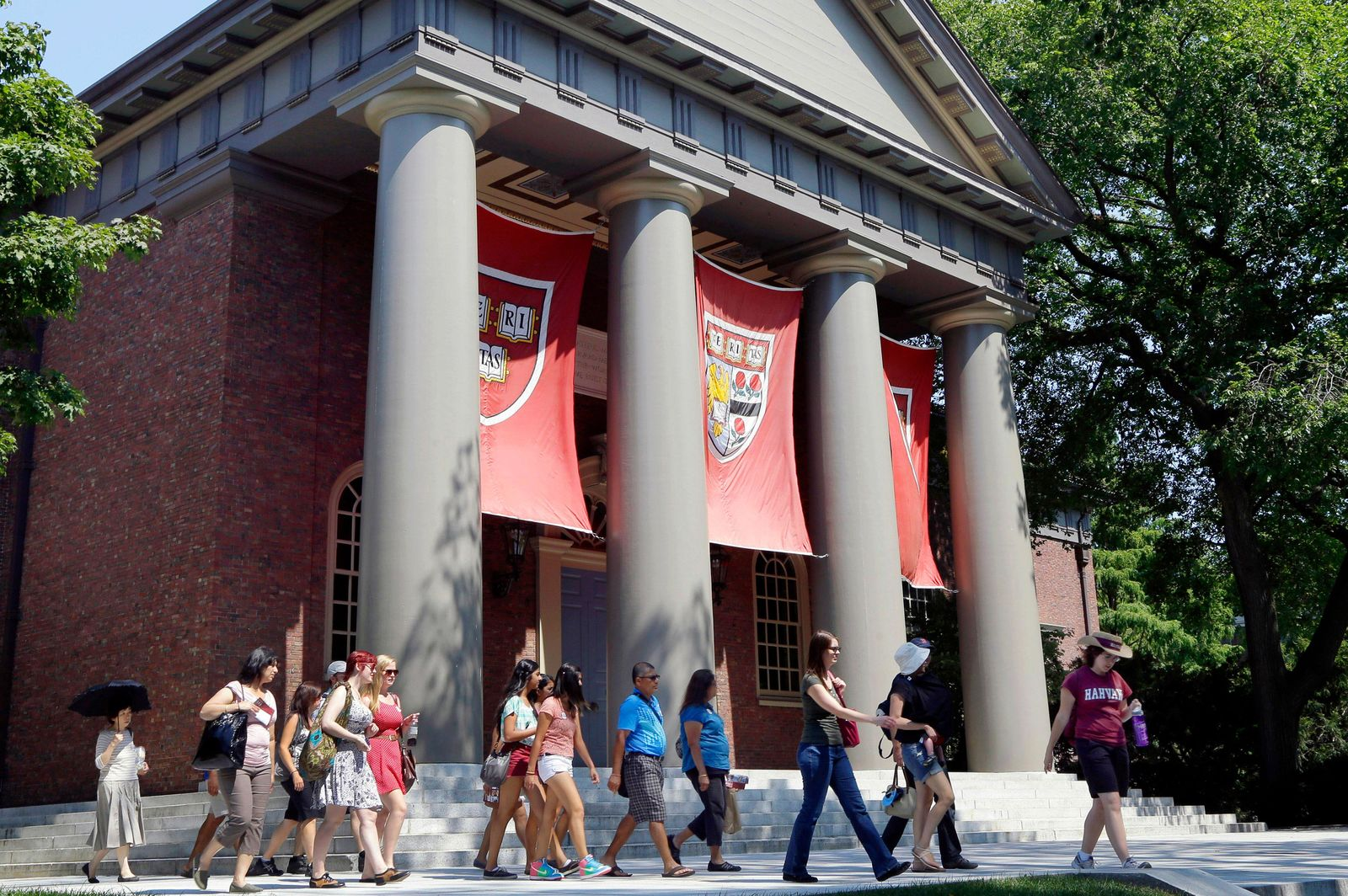 FILE - In this Aug. 30, 2012, file photo, a tour group walks through the campus of Harvard University in Cambridge, Mass. (AP Photo/Elise Amendola, File)