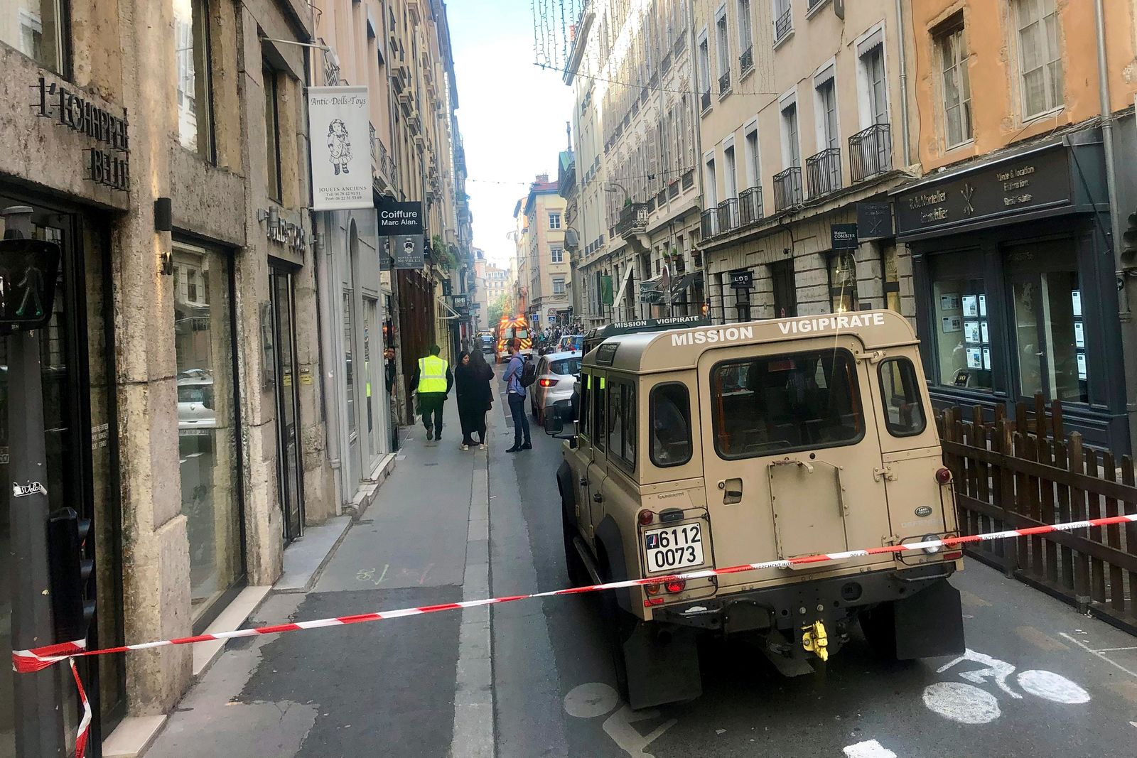 "A vehicle of French anti terrorist plan ""Vigipirate Mission"", is seen near the site of a suspected bomb attack in central Lyon, Friday May, 24, 2019. A small explosion Friday on a busy street in the French city of Lyon lightly injured several people, local officials said. (AP Photo/Sebastien Erome)"