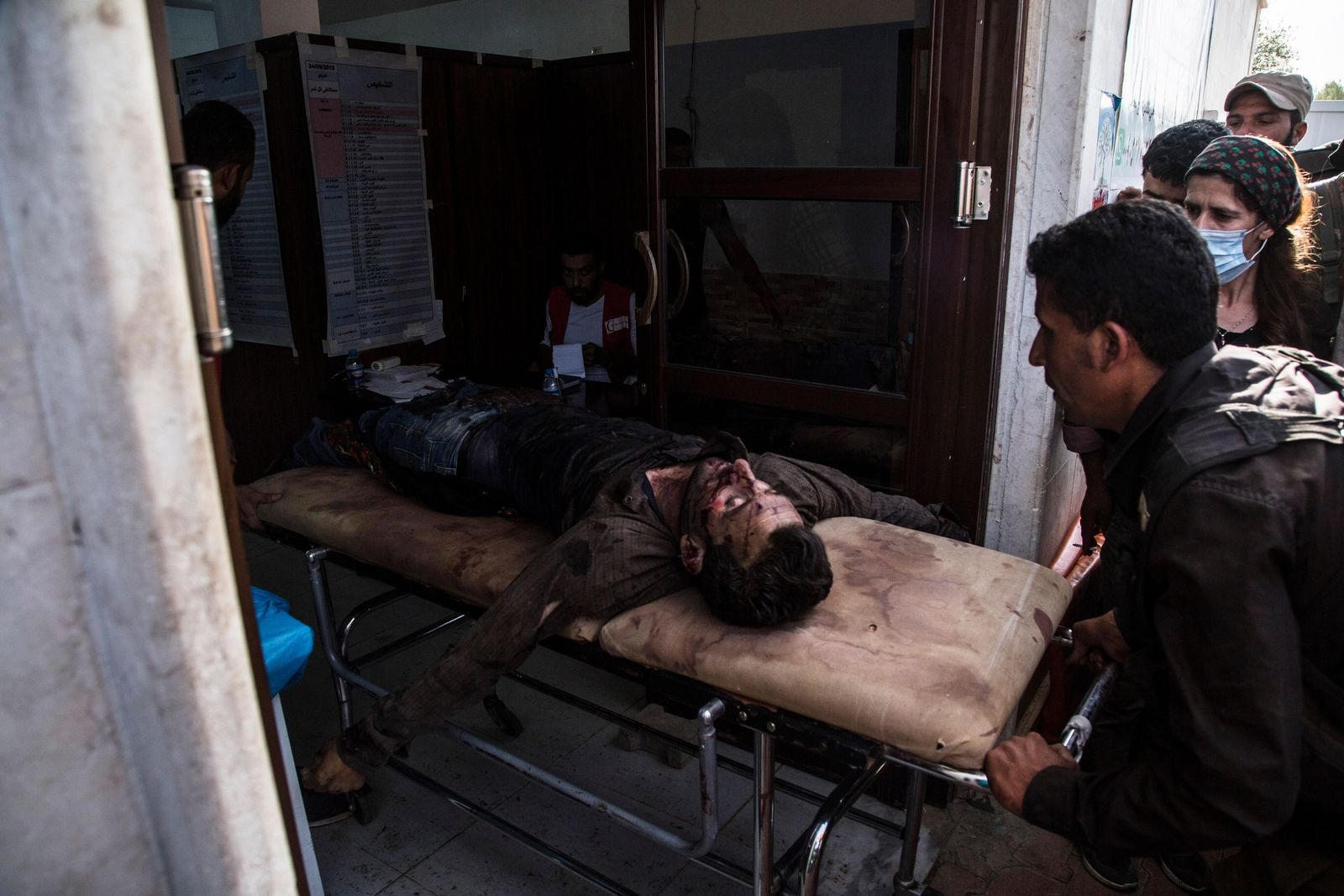A man wounded in Turkish shelling is brought to Tal Tamr hospital in north Syria, Monday, Oct. 14, 2019. (AP Photo/Baderkhan Ahmad)