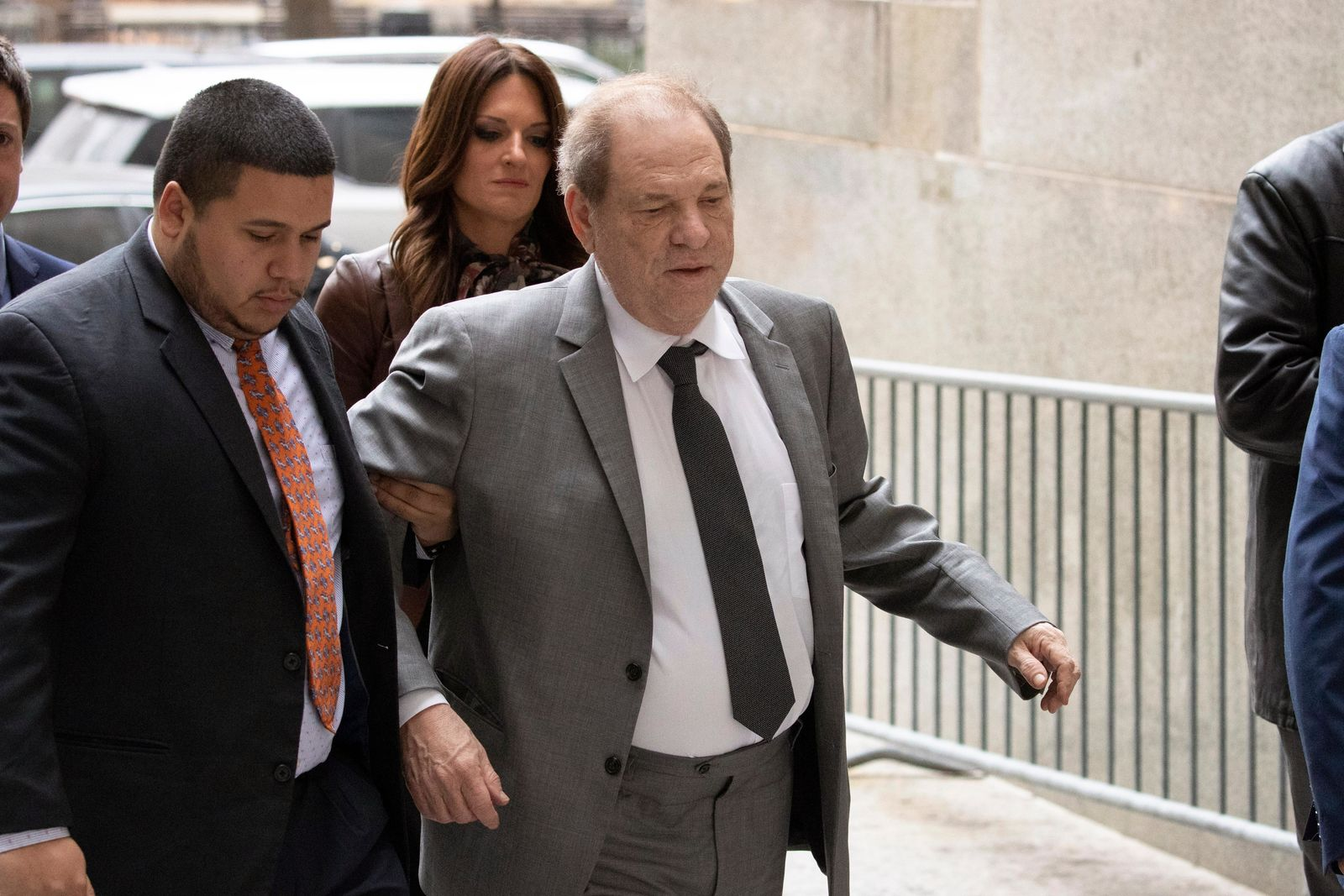 Harvey Weinstein, right, arrives at court for a bail hearing, Friday, Dec. 6, 2019 in New York. (AP Photo/Mark Lennihan)