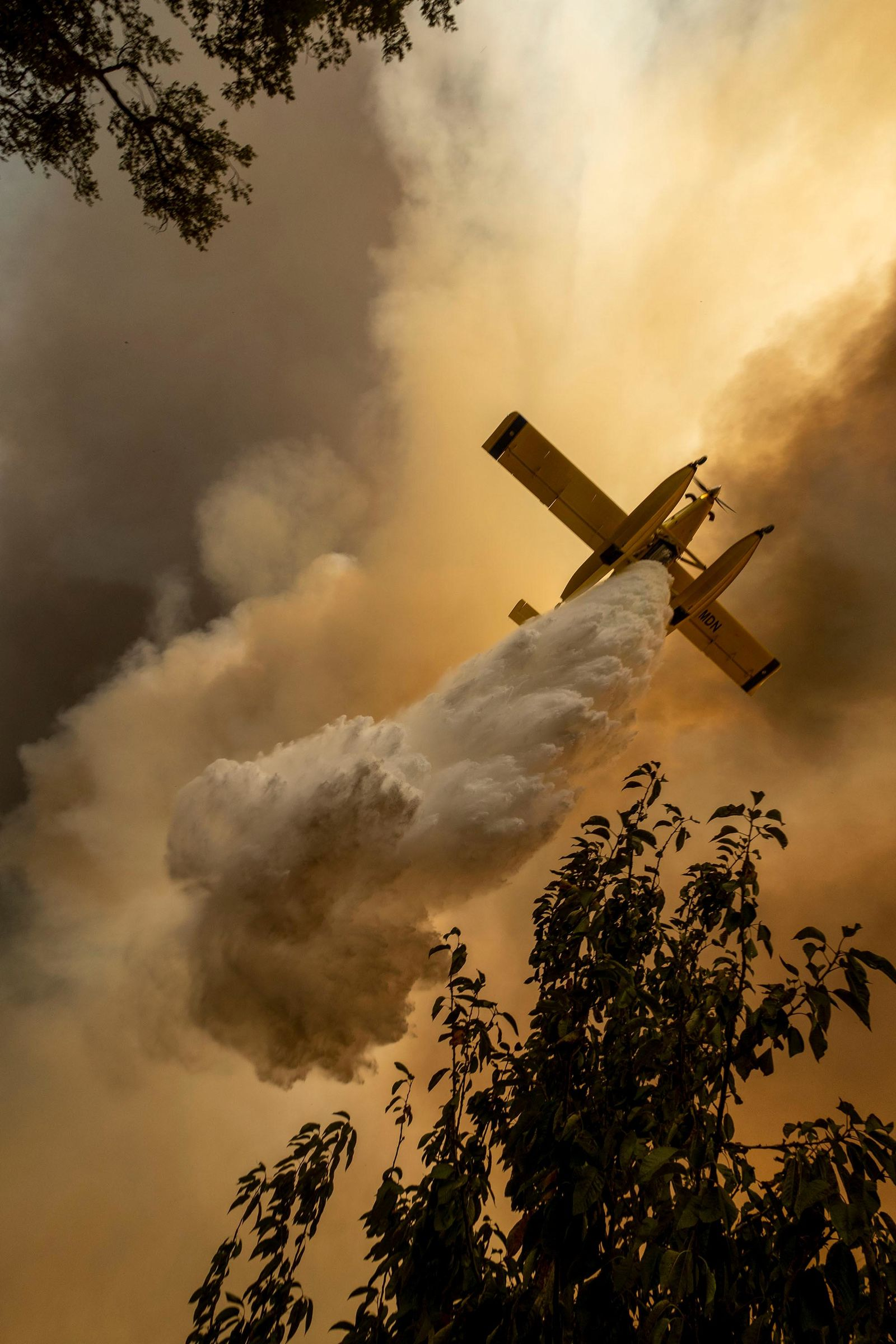 An airplane operates over a fire at the village of Chaveira, near Macao, in central Portugal on Monday, July 22, 2019.{ } (AP Photo/Sergio Azenha)