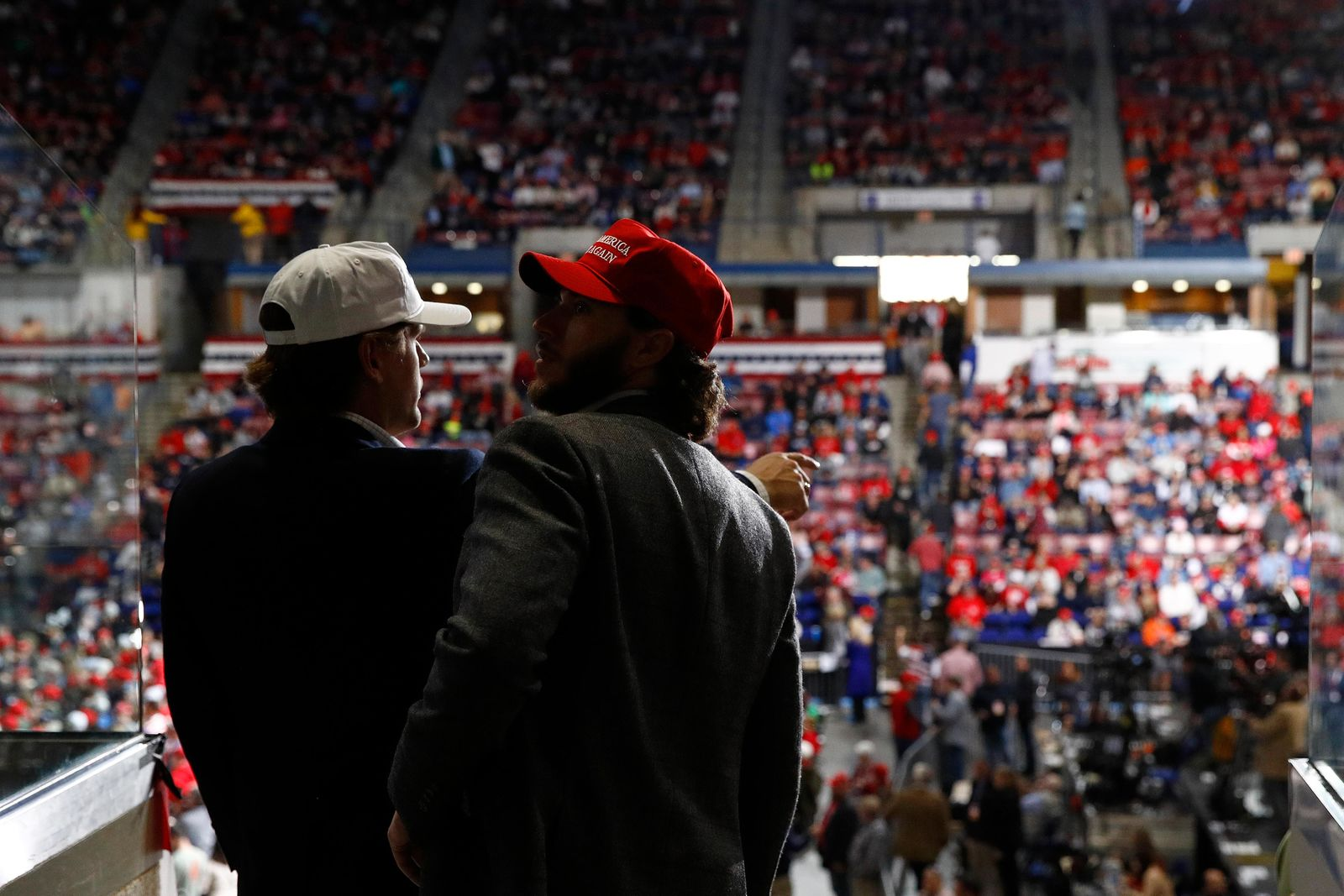 Attendees look for seats before a campaign rally for President Donald Trump, Friday, Feb. 28, 2020, in North Charleston, S.C. (AP Photo/Patrick Semansky)