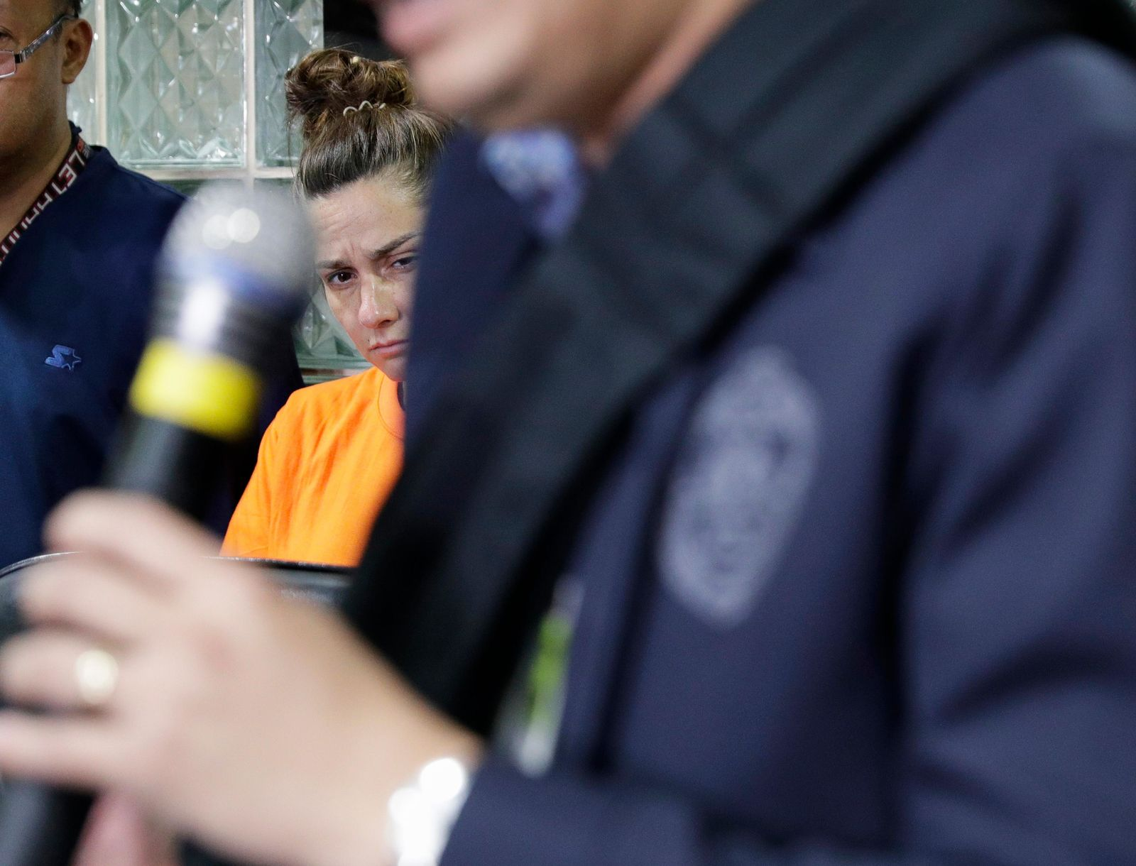 American Jennifer Erin Talbot from Ohio listens during a press conference by the National Bureau of Investigation (NBI) in Manila, Philippines on Thursday, Sept. 5, 2019. The NBI said that the 43-year-old Talbot was arrested at the Ninoy Aquino International Airport yesterday for trying to bring out of the country a 6-day old Filipino baby without proper travel documents. (AP Photo/Aaron Favila)
