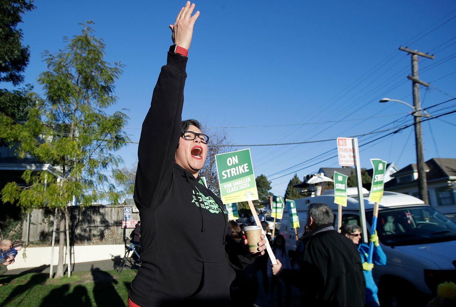 Esperanza Martinez, union member with United Teachers of Los Angeles, gestures while teachers and supporters march outside of Manzanita Community School in Oakland, Calif., Thursday, Feb. 21, 2019.{ } (AP Photo/Jeff Chiu)