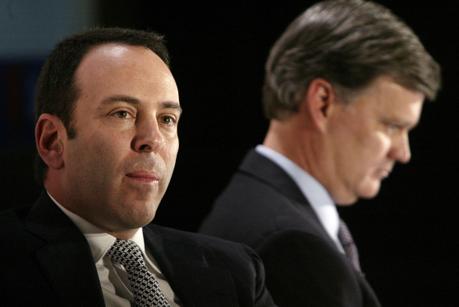 FILE- In this Nov. 17, 2004, file photo Kmart chairman Edward Lampert, left, and Sears CEO Alan Lacy listen during a news conference to announce the merger of Kmart and Sears in New York. (AP Photo/Gregory Bull, File)