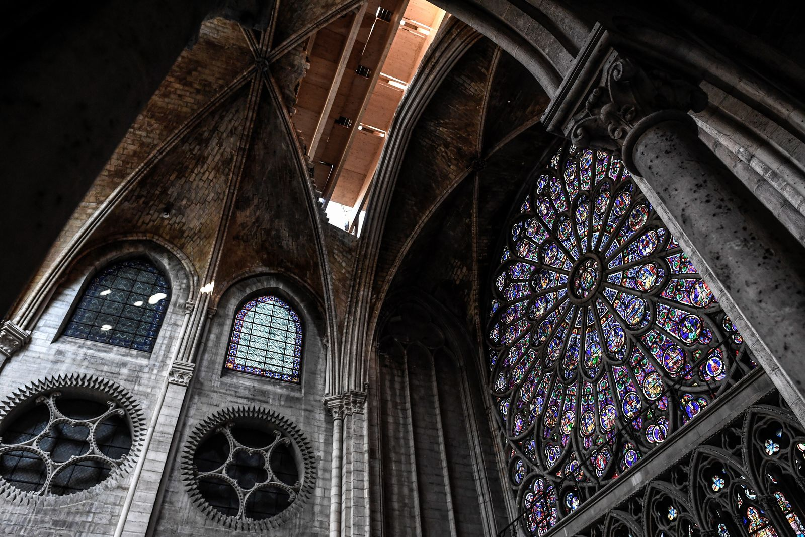 The rose window is pictured during preliminary work in the Notre-Dame de Paris Cathedral three months after a major fire Wednesday, July 17, 2019 in Paris. The chief architect of France's historic monuments says that three months after the April 15 fire that devastated Notre Dame Cathedral the site is still being secured. (Stephane de Sakutin/Pool via AP)