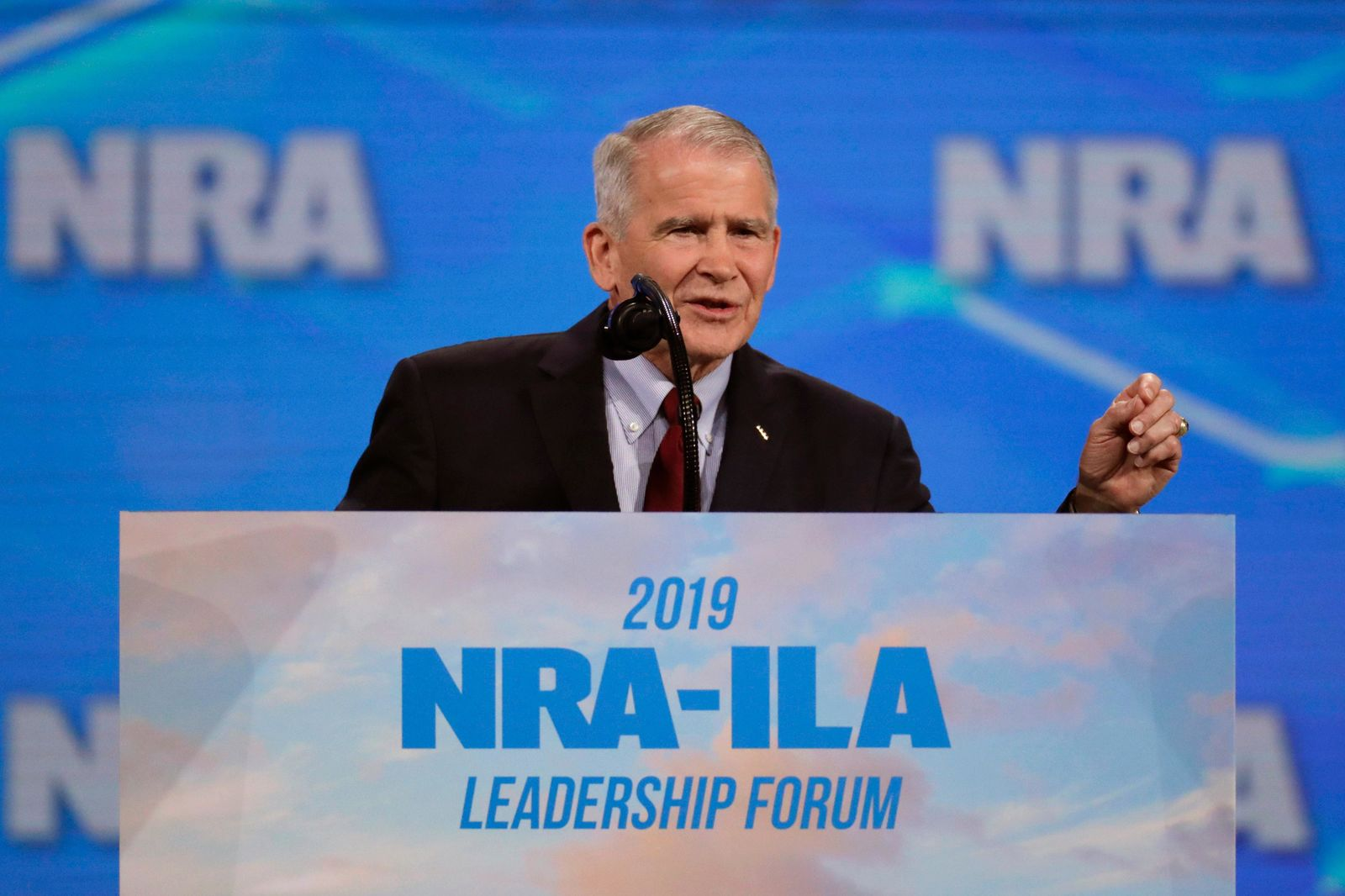 FILE- In this April 26, 2019 photo, Nation Rifle Association President Col. Oliver North speaks at the National Rifle Association Institute for Legislative Action Leadership Forum at Lucas Oil Stadium in Indianapolis.{ } (AP Photo/Michael Conroy, File)