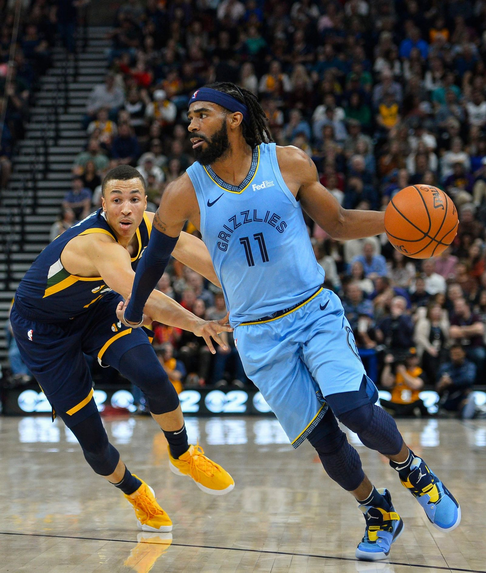 Memphis Grizzlies guard Mike Conley (11) drives past Utah Jazz guard Dante Exum (11) during the first half of an NBA basketball game Friday, Nov. 2, 2018, in Salt Lake City. (AP Photo/Alex Goodlett)
