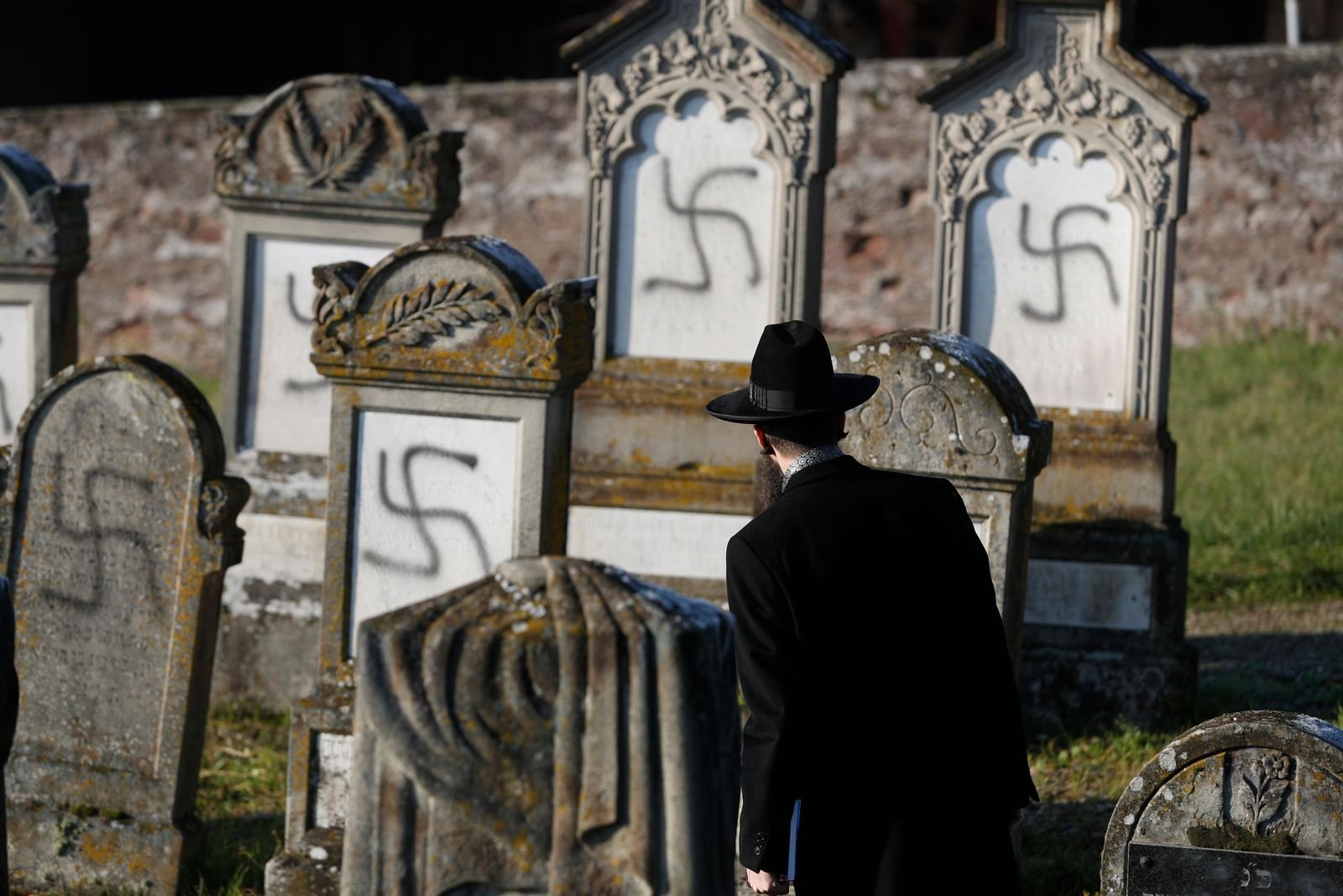 Strasbourg chief Rabbi Harold Abraham Weill watches vandalized tombs in the Jewish cemetery of Westhoffen, west of the city of Strasbourg, eastern France, Wednesday, Dec. 4, 2019.{ } (AP Photo/Jean-Francois Badias)