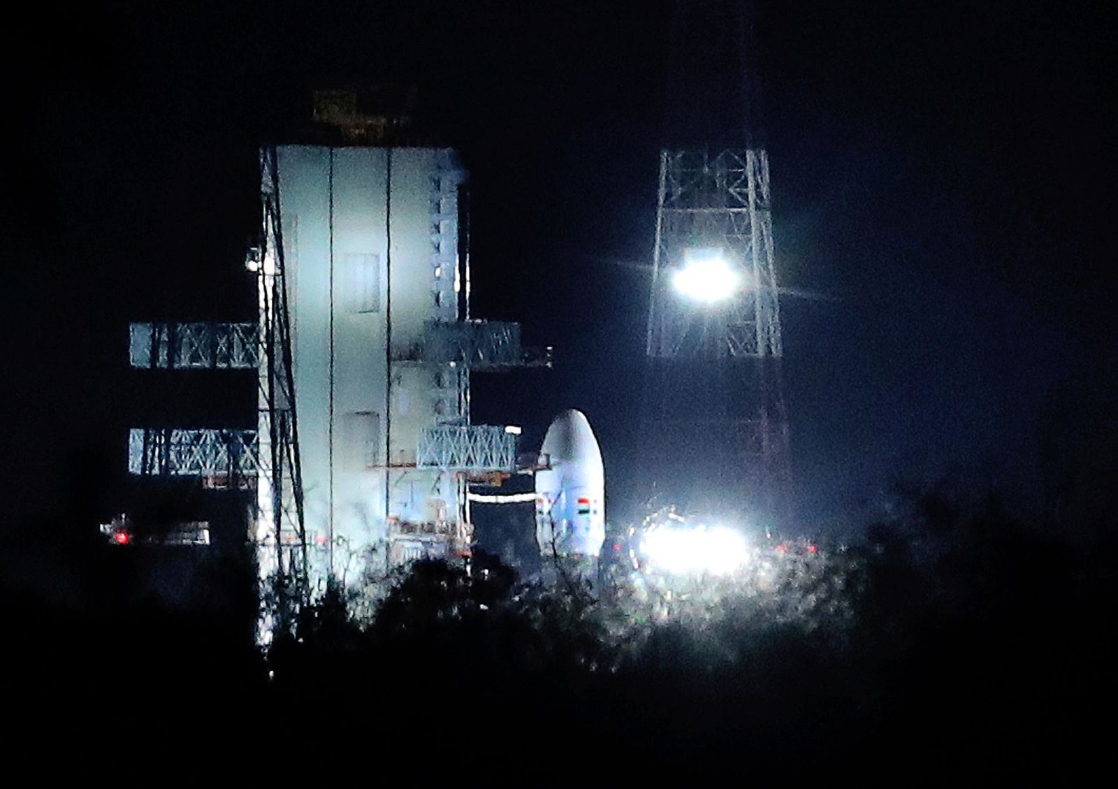 Indian Space Research Organization (ISRO)'s Geosynchronous Satellite launch Vehicle (GSLV) MkIII carrying Chandrayaan-2 stands at Satish Dhawan Space Center after the mission was aborted at the last minute at Sriharikota, in southern India, Monday, July 15, 2019.{ } (AP Photo/Manish Swarup)