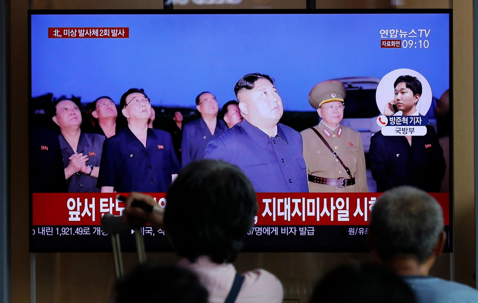 People watch a TV news program reporting about North Korea's firing projectiles with a file image of North Korean leader Kim Jong Un at the Seoul Railway Station in Seoul, South Korea, Friday, Aug. 16, 2019. AP Photo/Lee Jin-man)