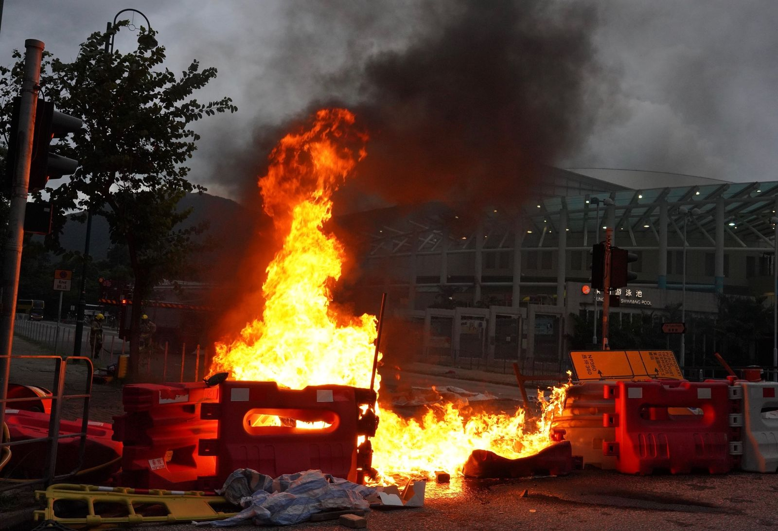 Protesters set fire to road barriers at Tung Chung near airport in Hong Kong, Sunday, Sept.1, 2019.{ } (AP Photo/Vincent Yu)