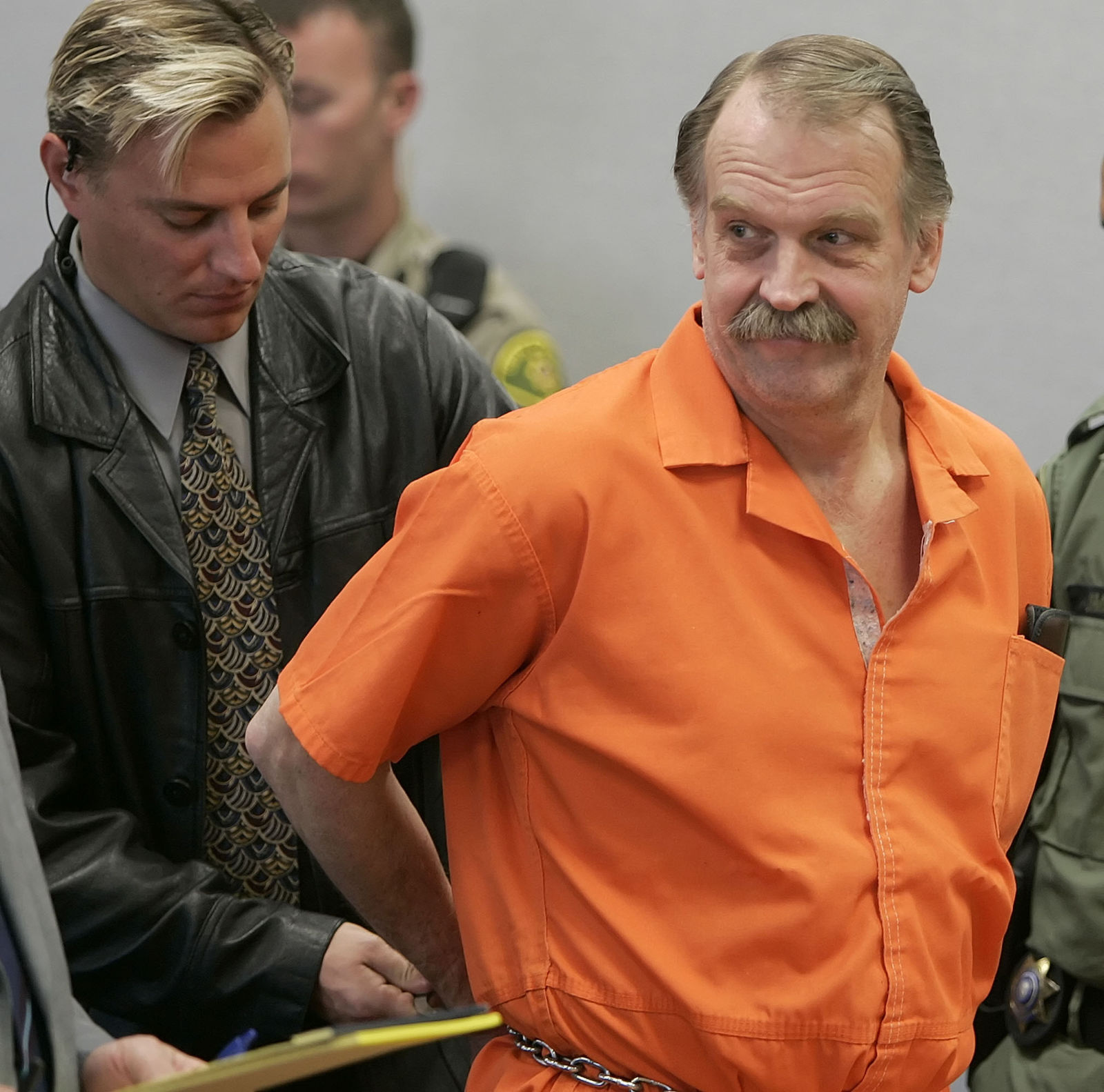 "FILE - In this Oct. 6, 2005 file photo, convicted murderer and death row inmate Ron Lafferty is handcuffed after his court hearing in a courtroom in Provo, Utah. Utah prison officials said Monday, Nov. 11, 2019, that Lafferty, a death-row inmate whose double-murder case was featured in the book ""Under the Banner of Heaven"" and who was nearing an execution by firing squad, has died of natural causes. (AP Photo/George Frey, File)"