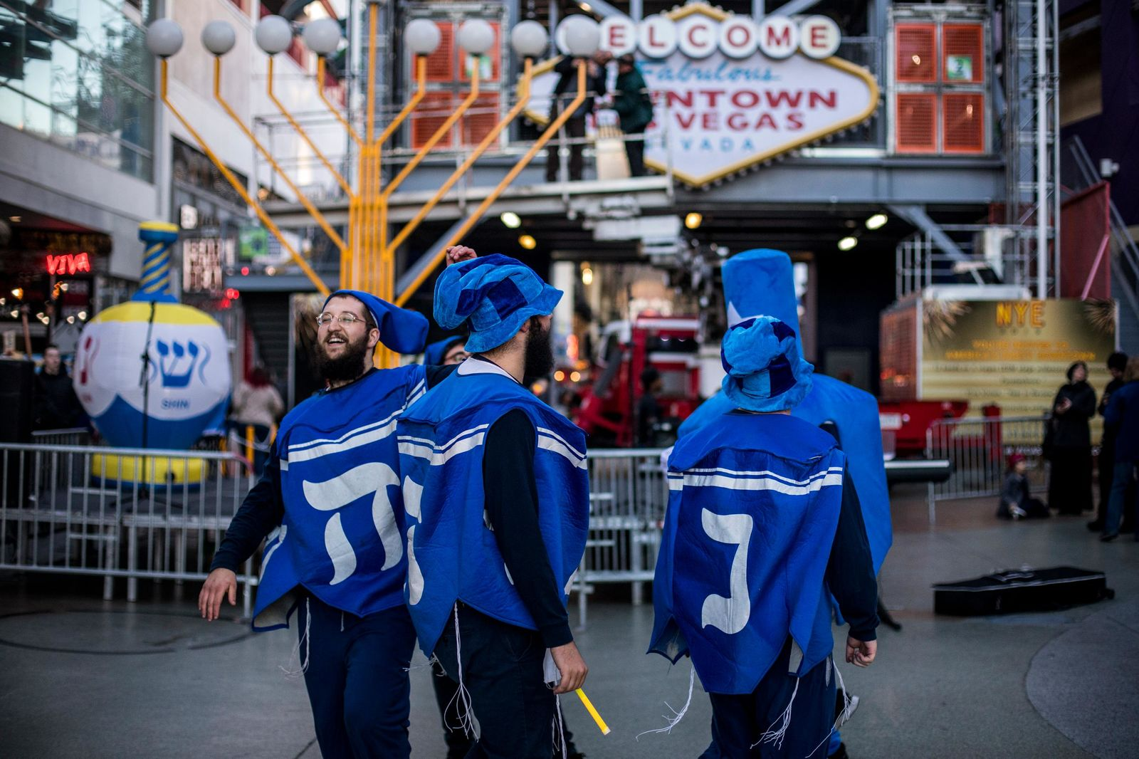 Shlomo Sirota and the dancing menorahs pump up the crowd before the start of the Grand Menorah lighting Sunday, Dec. 2 on Fremont Street. The ceremony featured a 20-foot Grand Menorah, which will remain on display throughout the Hanukkah season. CREDIT: Joe Buglewicz/Las Vegas News Bureau