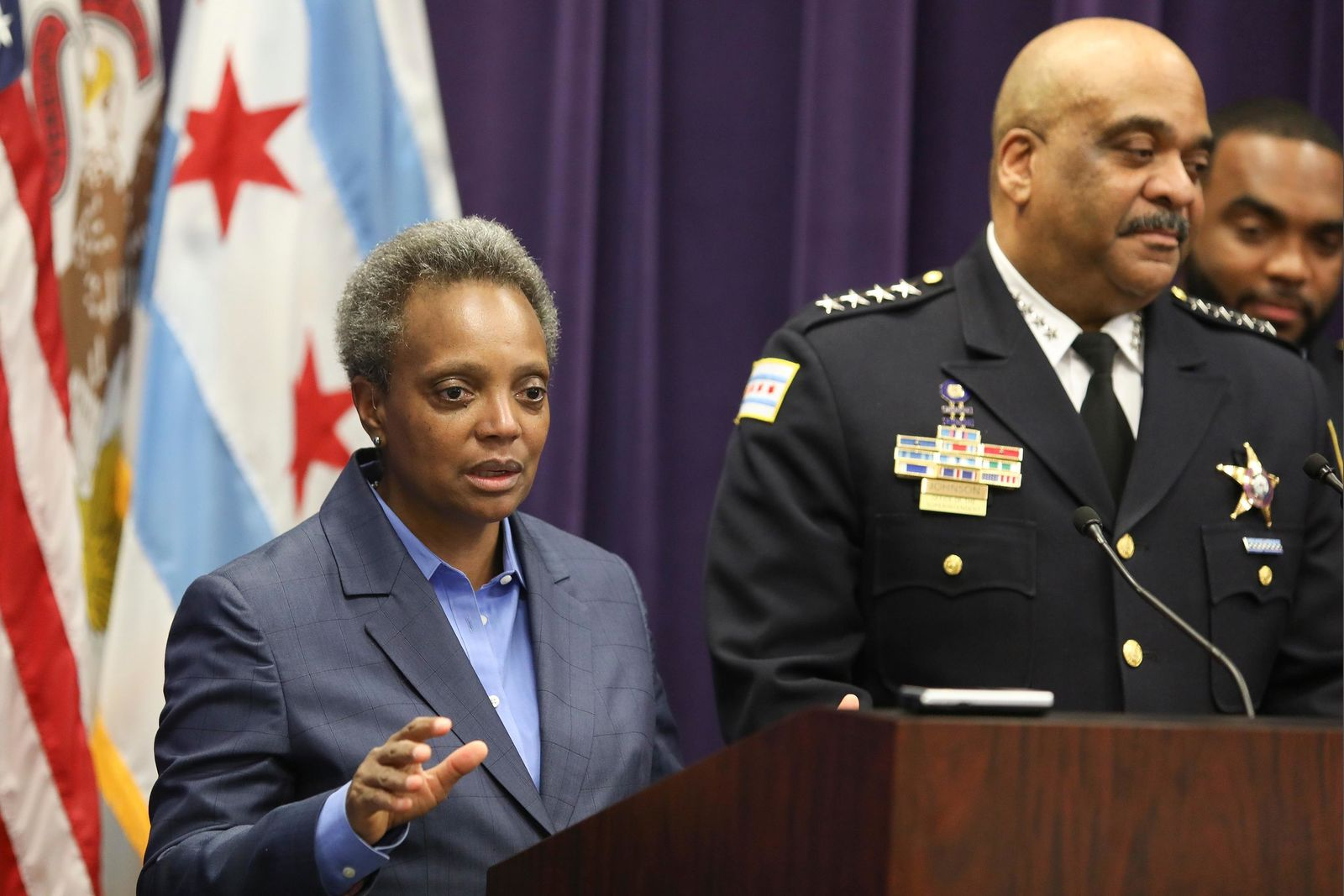 "FILE - In this Nov. 7, 2019 file photo, Mayor Lori Lightfoot speaks as Chicago Police Superintendent Eddie Johnson announces his retirement after more than three years leading the department in Chicago. Mayor Lightfoot  fired Police Supt. Eddie Johnson Monday Dec. 2, 2019, due to his ""ethical lapses.""(AP Photo/Teresa Crawford File)"