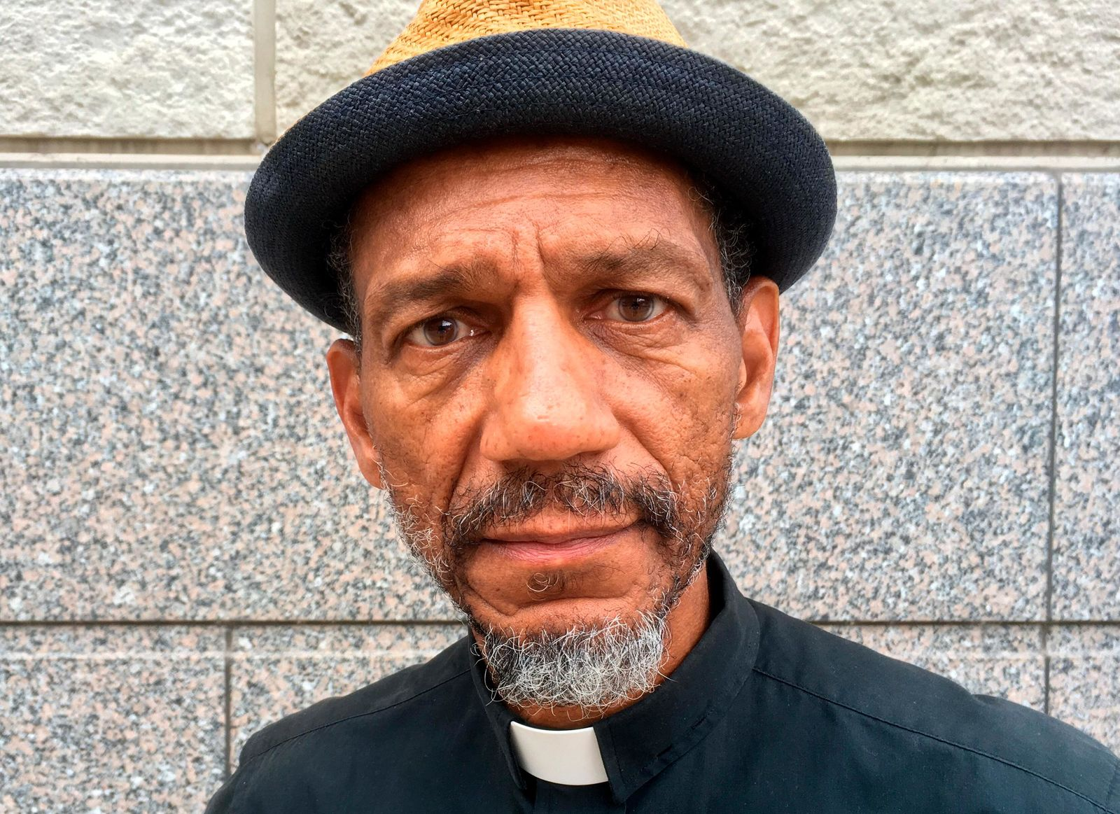 FILE - In this Oct. 5, 2017 file photo, Darryl Gray, a pastor with deep roots in civil rights activism who serves as a mentor to the unofficial leaders of the so-called Frontline protest movement, poses for a photo in St. Louis. (AP Photo/ Jim Salter, File)