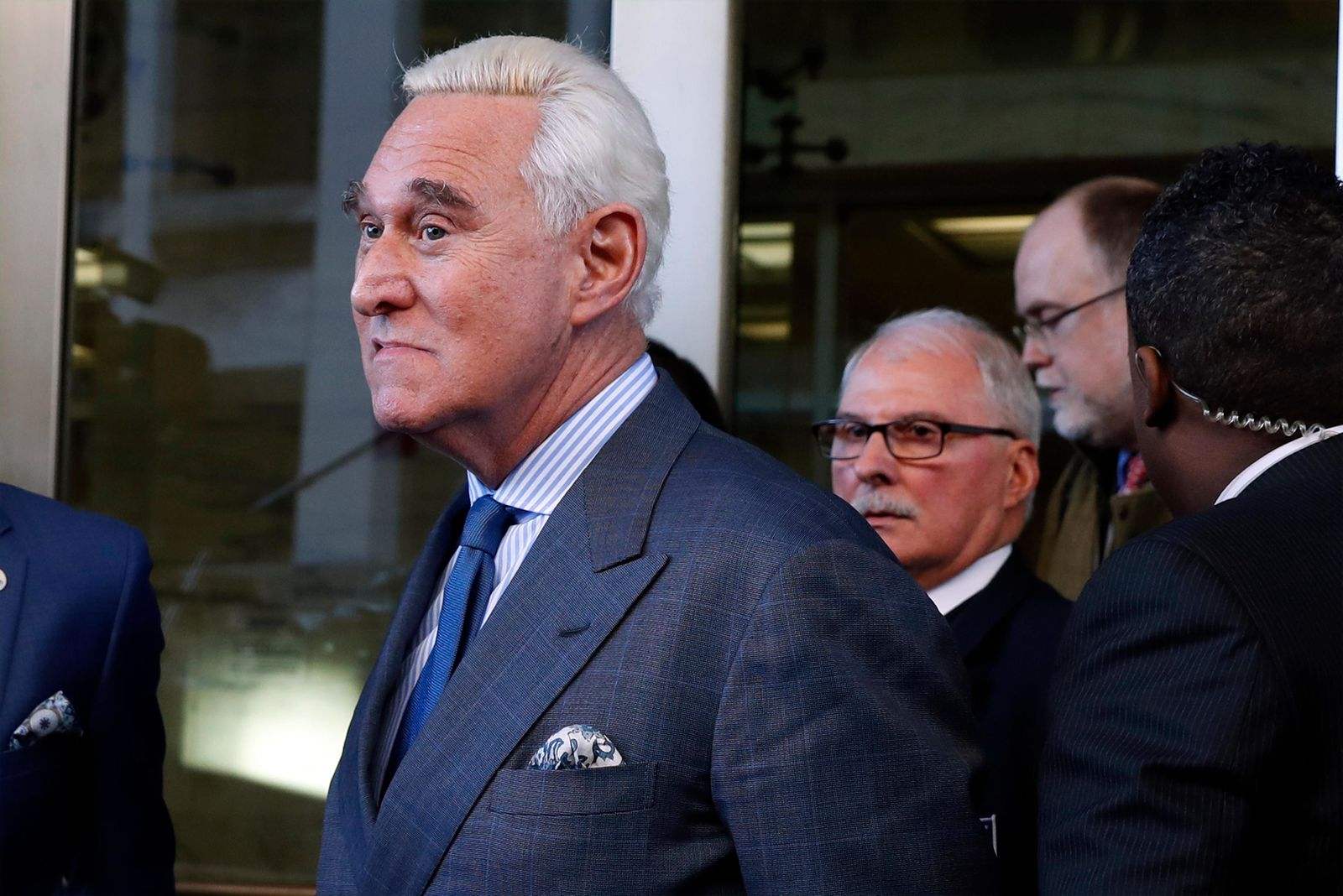 In this Feb. 21, 2019, photo, former campaign adviser for President Donald Trump, Roger Stone, leaves federal court in Washington. (AP Photo/Jacquelyn Martin)
