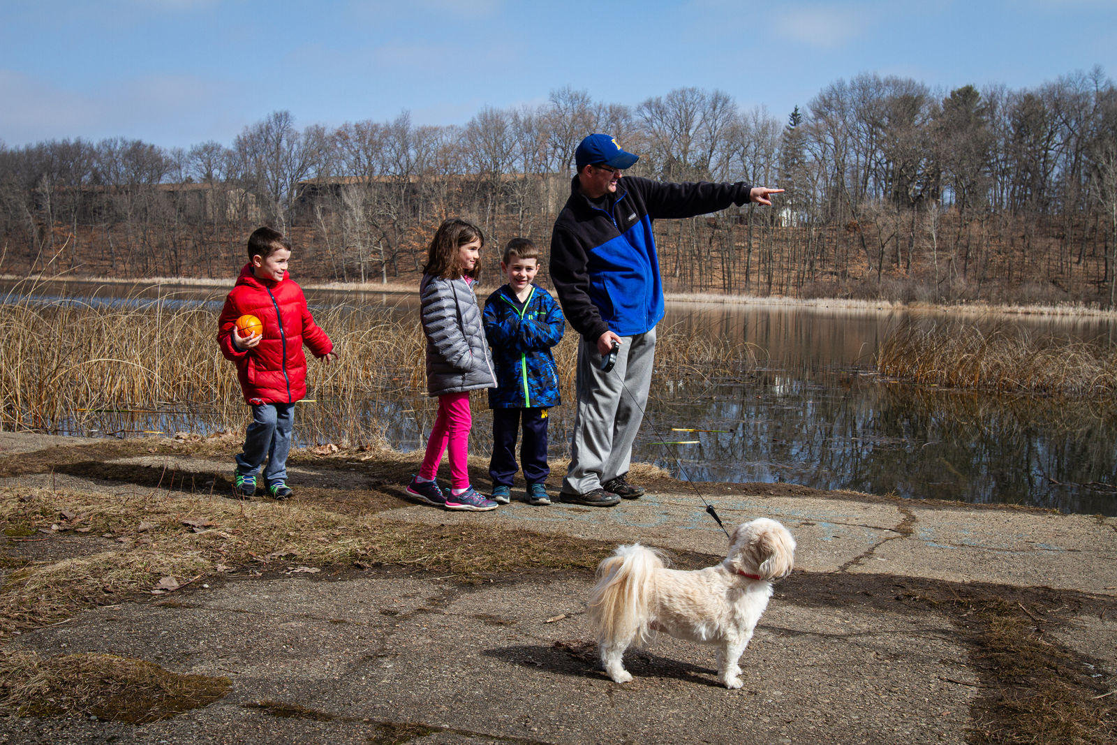 The Williams family from Lawton, Michigan watches birds at Asylum Lake Preserve on Wednesday, March 25.{ }(WWMT/Sarah White)
