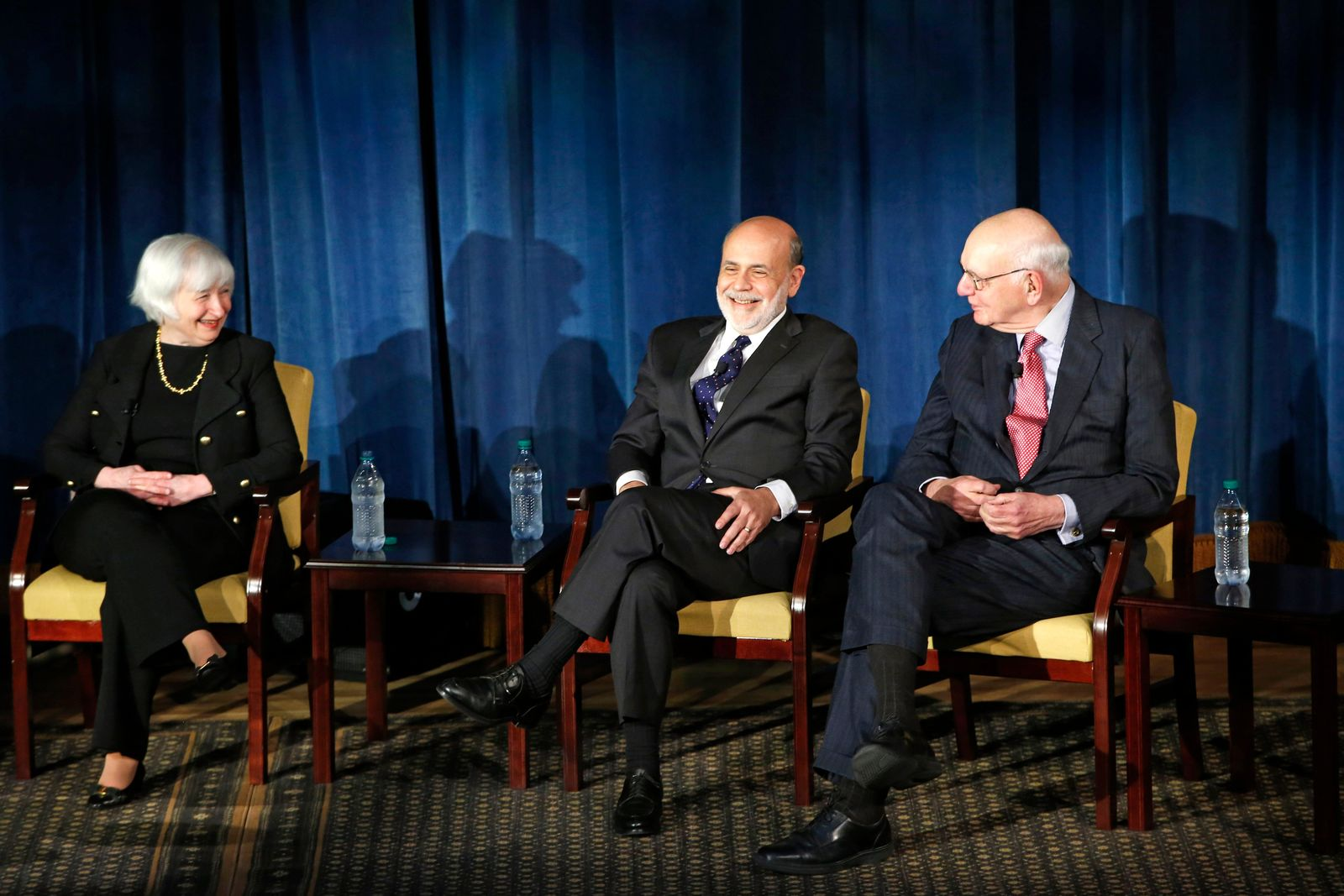 FILE - In this April 7, 2016, file photo Federal Reserve chair Janet Yellen, left, and former Federal Reserve chairs Ben Bernanke, center, and Paul Volcker, right, react as they listen to former Fed Chair Alan Greenspan appearing via video conference, during a panel discussion in New York. Volcker, the former Federal Reserve chairman died on Sunday, Dec. 8, 2019, according to his office, He was 92.{ }(AP Photo/Kathy Willens, File)