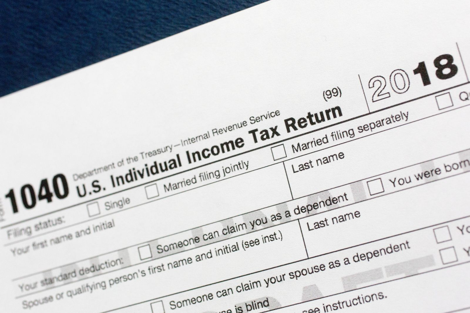 FILE- This July 24, 2018, file photo shows a portion of the 1040 U.S. Individual Income Tax Return form for 2018 in New York. (AP Photo/Mark Lennihan, File)