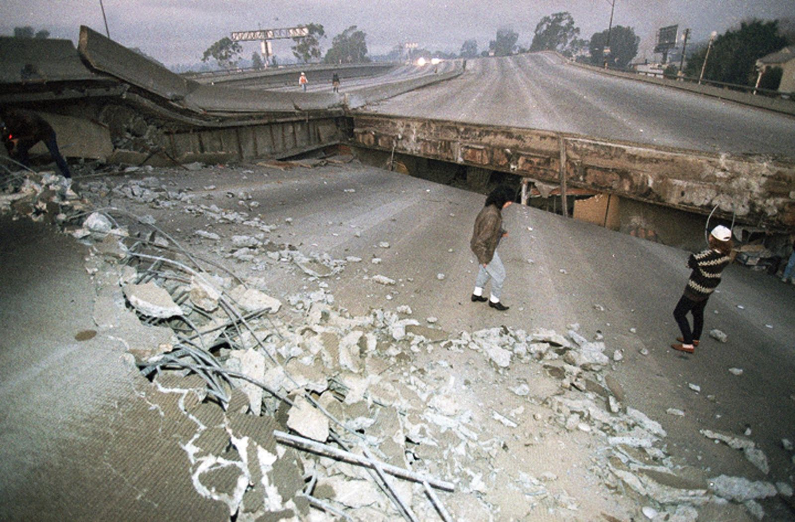 FILE - In this Jan. 17, 1994, file photo, Interstate 10, the Santa Monica Freeway, split and collapsed over La Cienega Boulevard following the Northridge quake in the predawn hours in Los Angeles.  (AP Photo/Eric Draper, File)