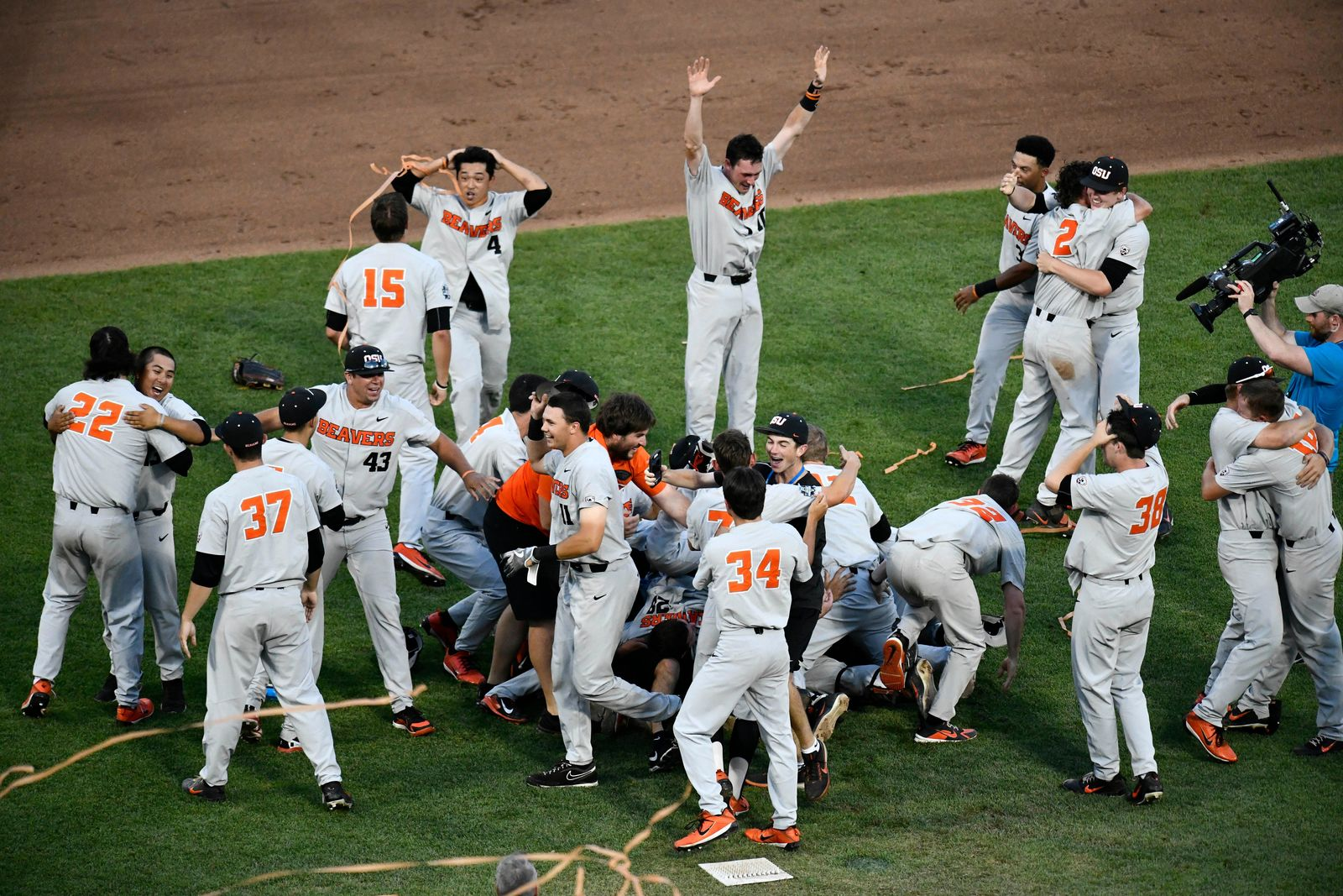 Oregon State players celebrate after winning Game 3 of the NCAA College World Series baseball finals in Omaha, Neb., Thursday, June 28, 2018. Oregon State defeated Arkansas 5-0. (AP Photo/Ashley Pales)