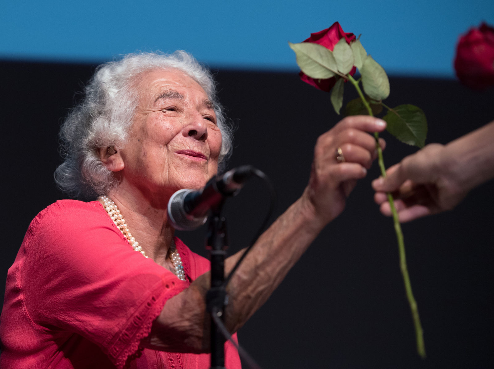 "FILE - In this Sept. 15, 2016 file photo British writer Judith Kerr holds a rose in Berlin, Germany. Judith Kerr, author and illustrator of the bestselling ""The Tiger Who Came to Tea"" and other beloved children's books, has died at the age of 95. ( Soeren Stache/dpa via AP)"