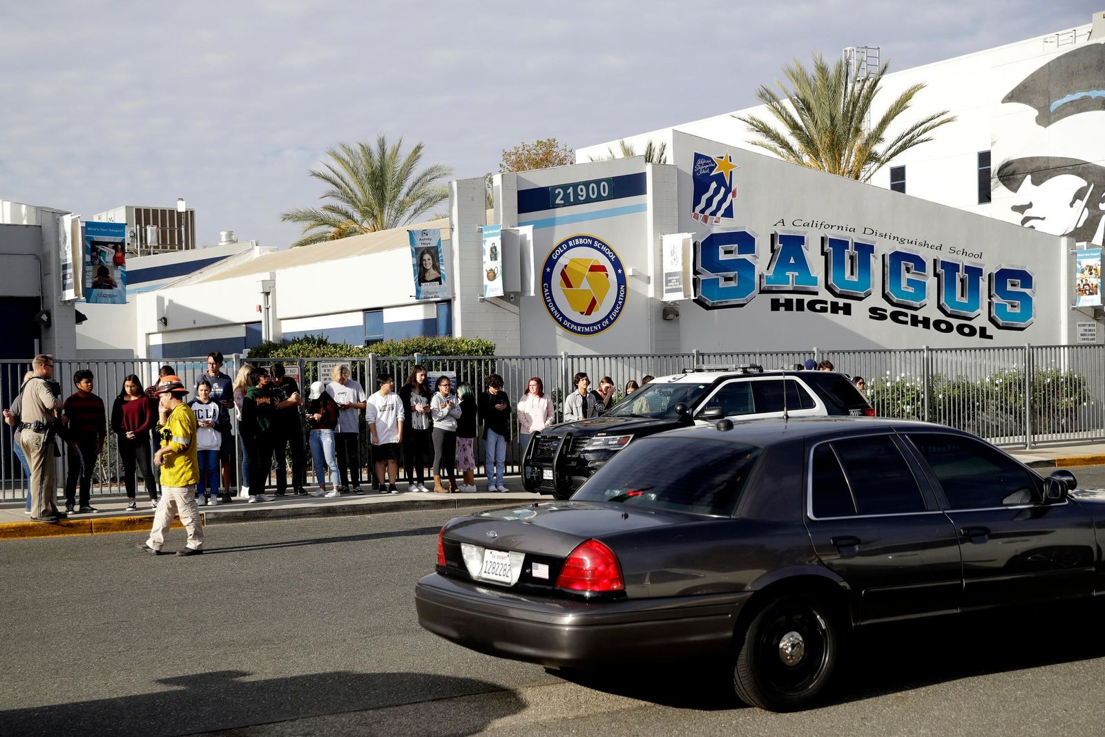 Students stand outside of Saugus High School after reports of a shooting on Thursday, Nov. 14, 2019, in Santa Clarita, Calif. (AP Photo/Marcio Jose Sanchez)