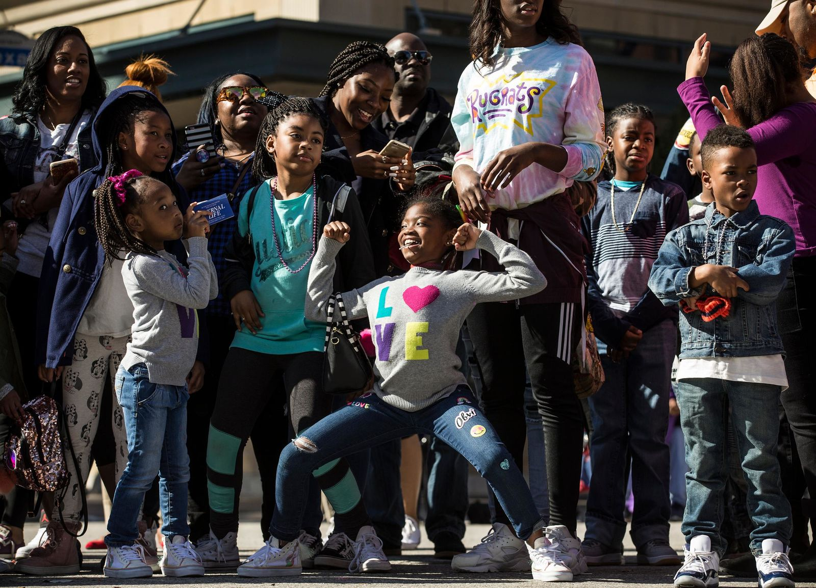 "In this Monday, Jan. 15, 2018 photo, people line Texas Avenue to watch The ""Original"" MLK, Jr. Parade in Houston. For more than two decades, competing MLK Day parades have been held in Houston. ( Brett Coomer/Houston Chronicle via AP)"