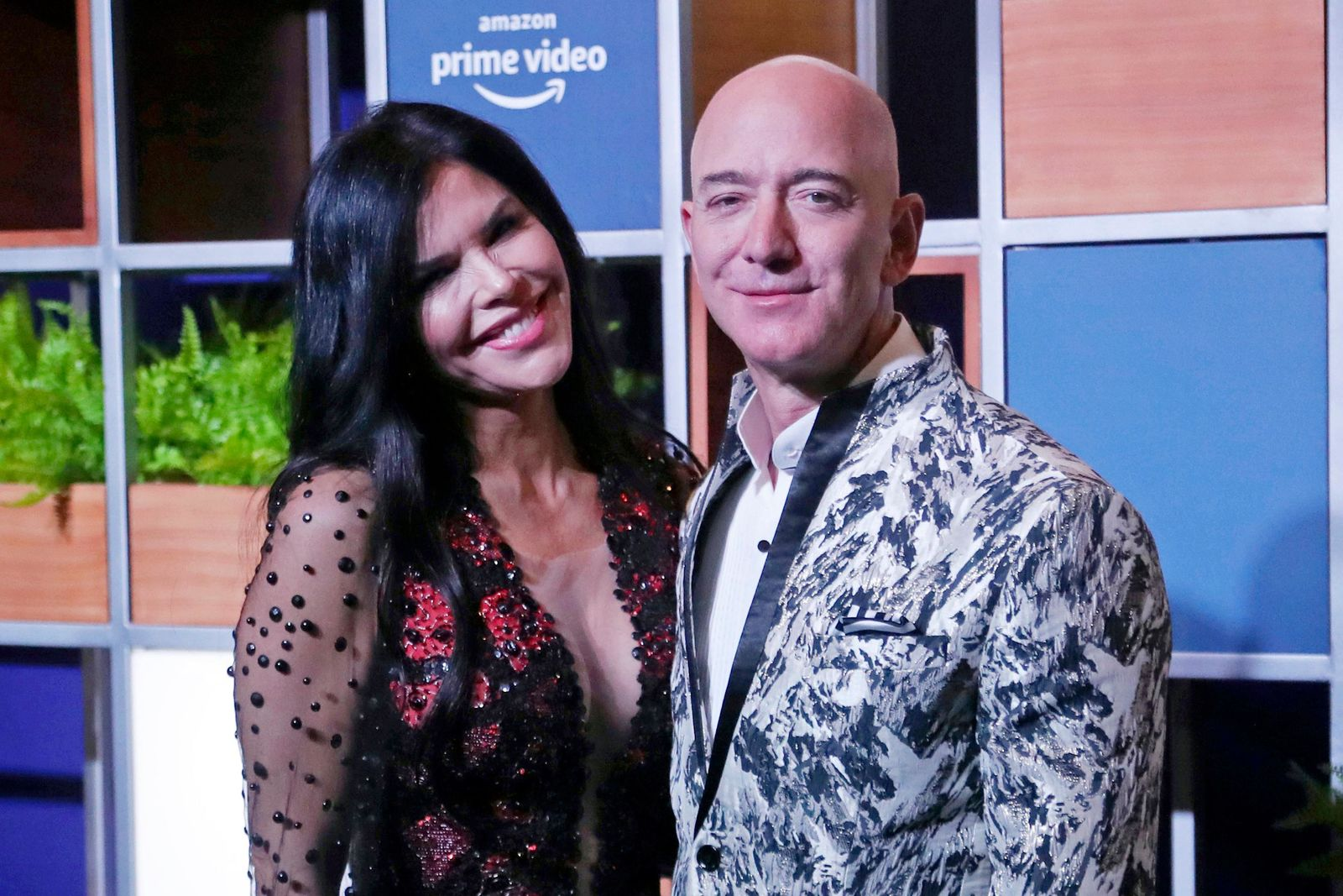 FILE - In this Jan. 16, 2020, file photo, Amazon CEO Jeff Bezos, right and his girlfriend Lauren Sanchez poses for photographs during a blue carpet event organized by Amazon Prime Video in Mumbai, India. (AP Photo/Rafiq Maqbool, File)