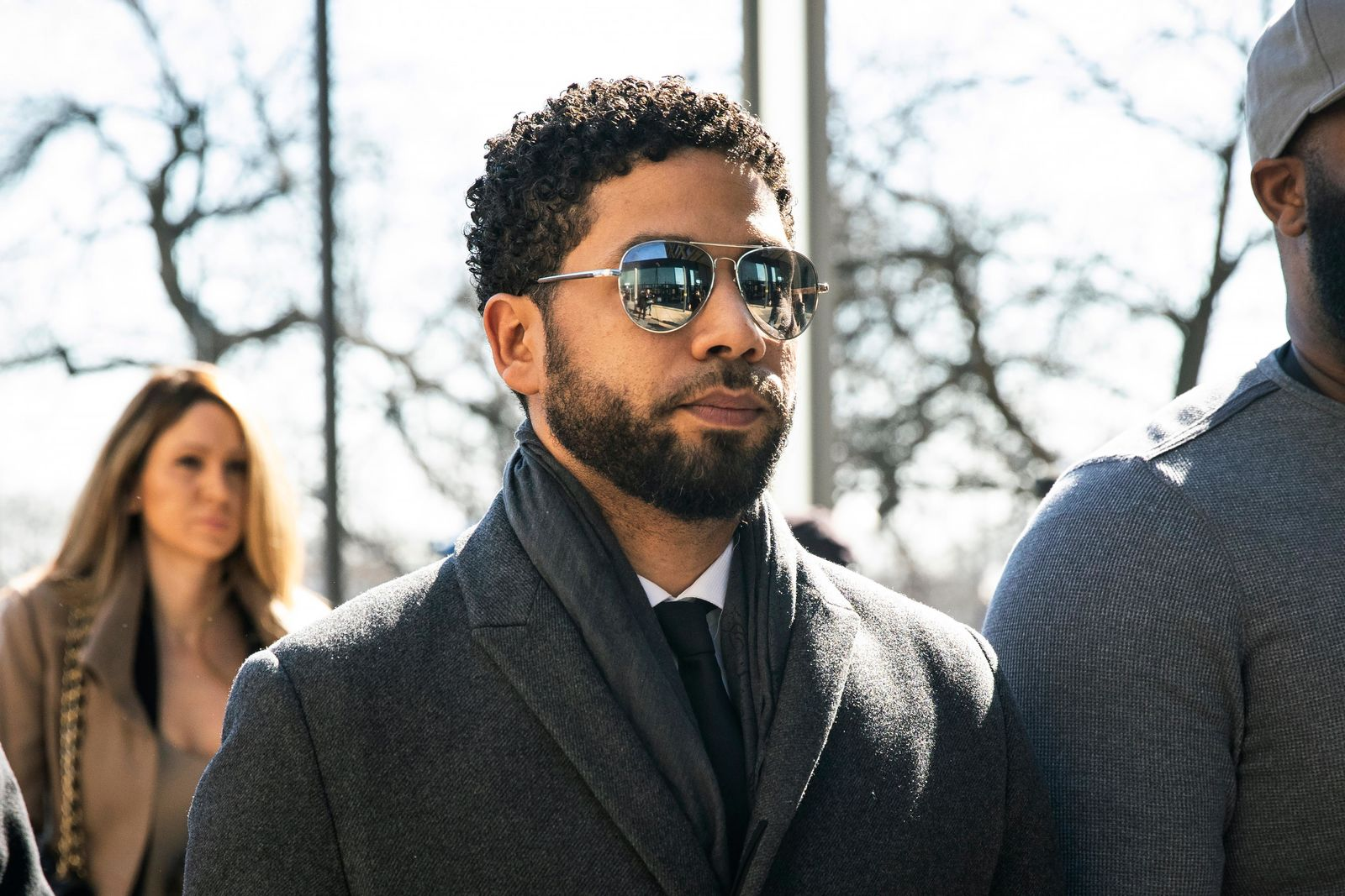"""Empire"" actor Jussie Smollett, center, arrives at Leighton Criminal Court Building for a hearing to discuss whether cameras will be allowed in the courtroom during his disorderly conduct case on Tuesday, March 12, 2019, in Chicago. (Ashlee Rezin/Chicago Sun-Times via AP)"