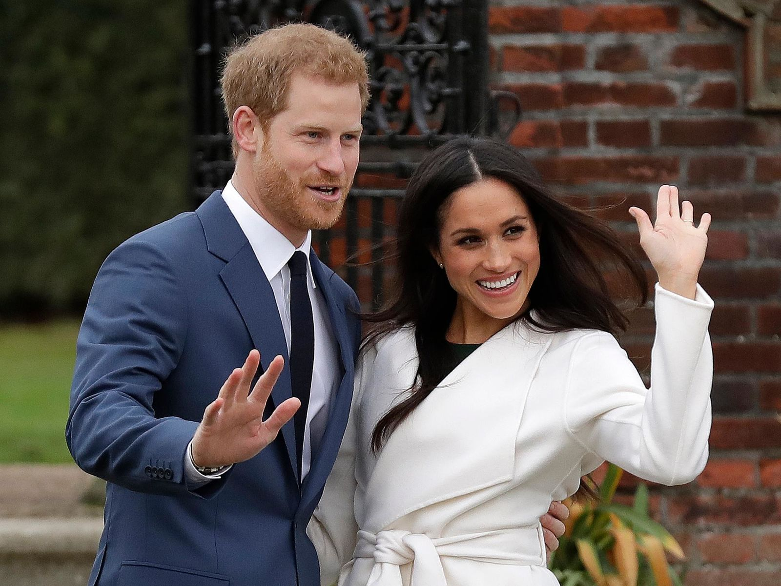 FILE - In this Monday, Nov. 27, 2017 file photo, Britain's Prince Harry and his fiancee Meghan Markle pose for photographers during a photocall in the grounds of Kensington Palace in London.{ } (AP Photo/Matt Dunham, File)