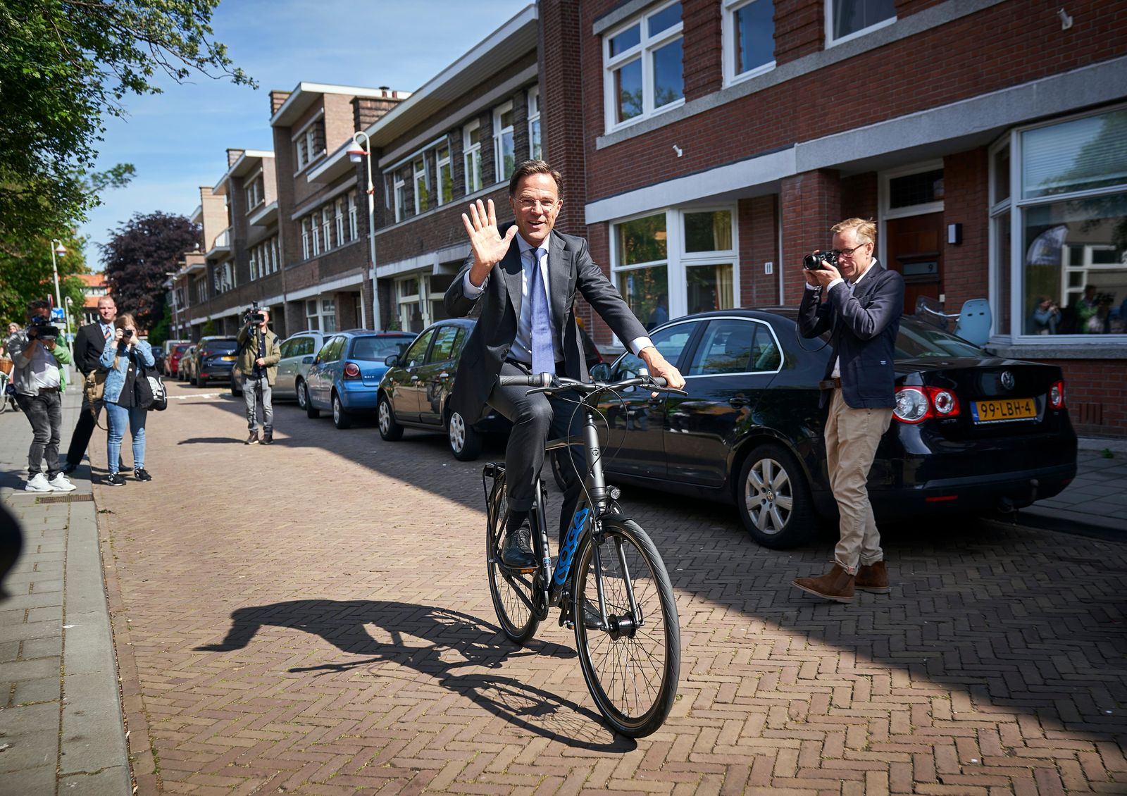 Netherlands Prime Minister Mark Rutte leaves on his bicycle after voting in the European elections in The Hague, Netherlands, Thursday, May 23, 2019. (AP Photo/Phil Nijhuis)