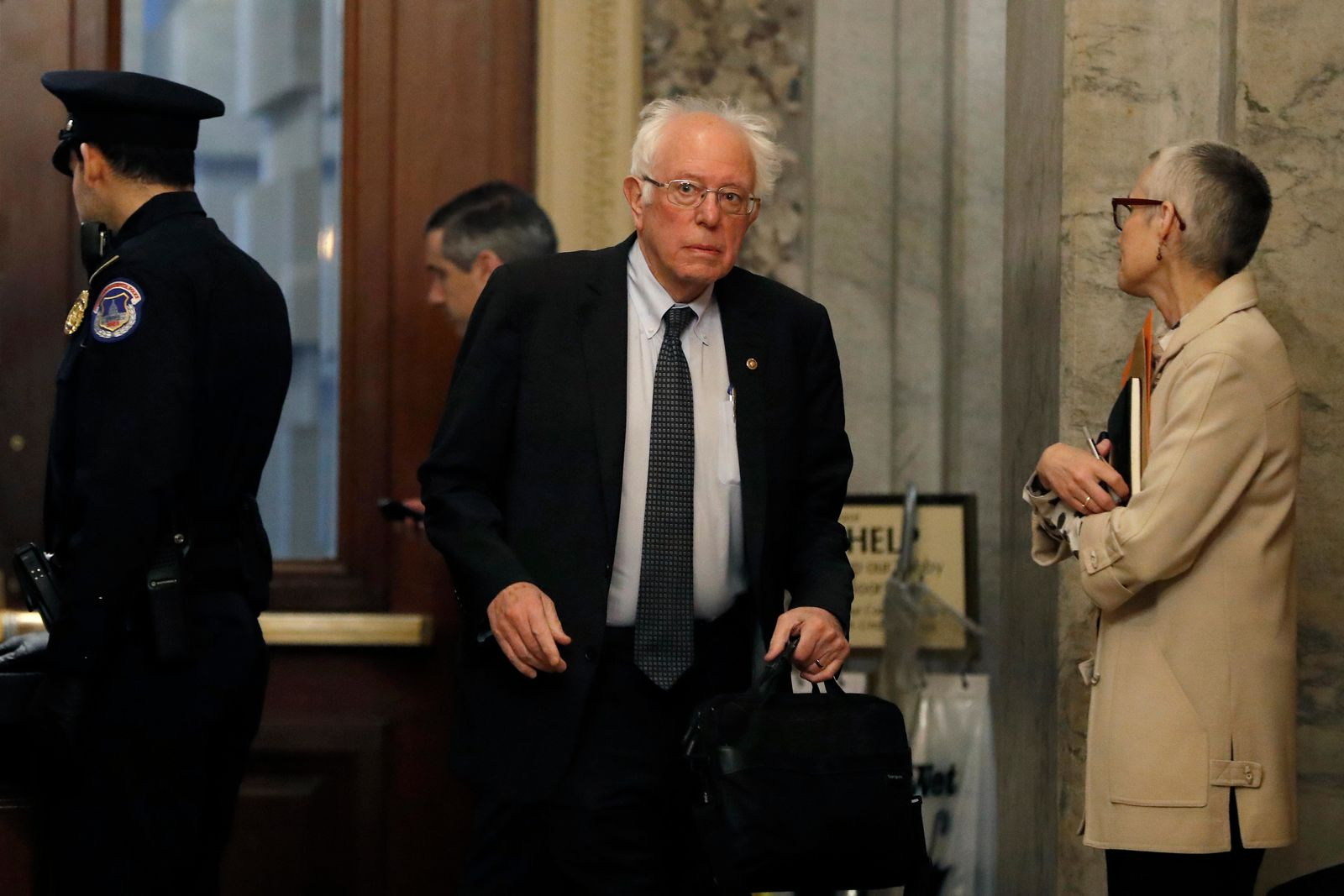 Sen. Bernie Sanders, I-Vt., arrives at the Capitol in Washington during the impeachment trial of President Donald Trump on charges of abuse of power and obstruction of Congress, Saturday, Jan. 25, 2020. (AP Photo/Julio Cortez)