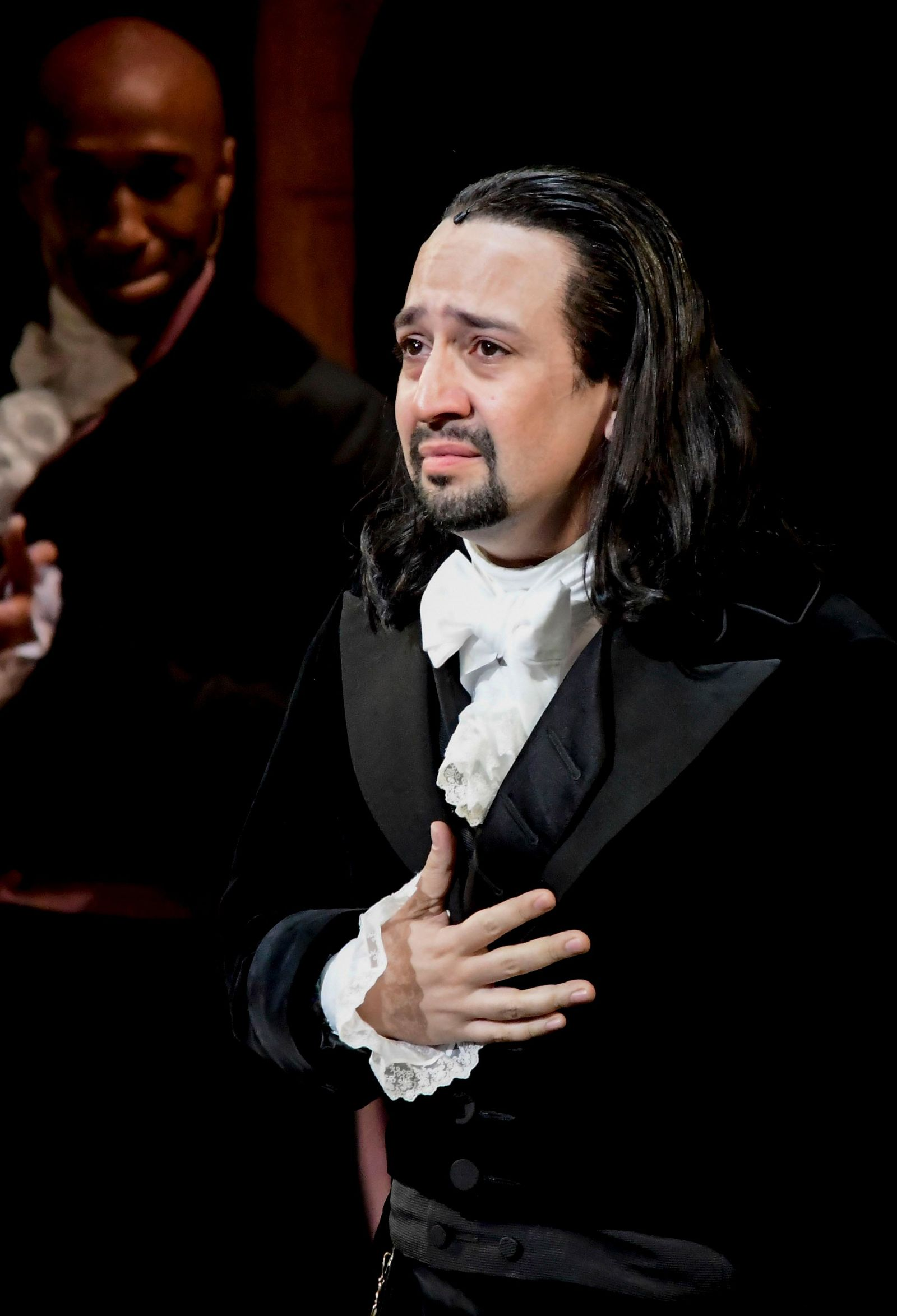 Lin-Manuel Miranda, composer and creator of the award-winning Broadway musical, Hamilton, receives a standing ovation with tears at the ending of the play's premiere held at the Santurce Fine Arts Center, in San Juan, Puerto Rico, Friday, Jan. 11, 2019. The musical is set to run for two weeks and will raise money for local arts programs. (AP Photo/Carlos Giusti)