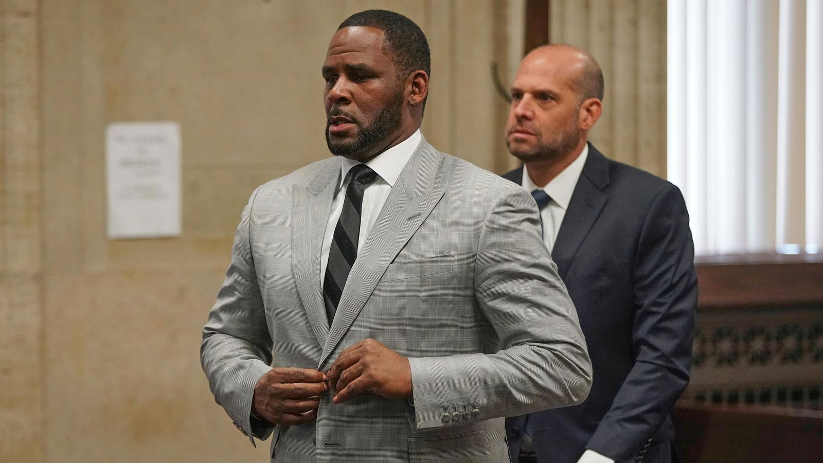 FILE - In this  June 6, 2019, file photo, singer R. Kelly pleaded not guilty to 11 additional sex-related felonies during a court hearing before Judge Lawrence Flood at Leighton Criminal Court Building in Chicago.{ } (E. Jason Wambsgans/Chicago Tribune via AP, Pool)