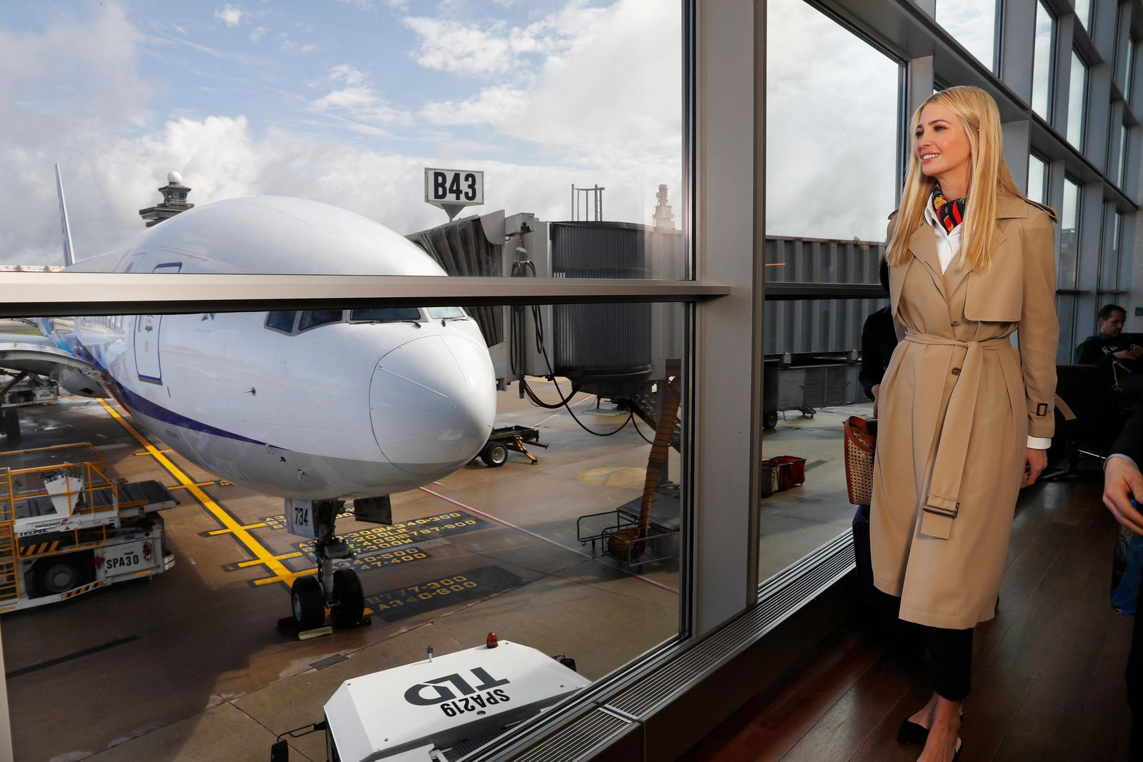 White House senior adviser Ivanka Trump walks past an airplane as she leaves an airport lounge before boarding a commercial flight from Dulles International Airport, in Sterling, Va., Saturday April 13, 2019, en route to Ethiopia. Trump will travel to Ethiopia and Ivory Coast to promote a global economical program for women. (AP Photo/Jacquelyn Martin)