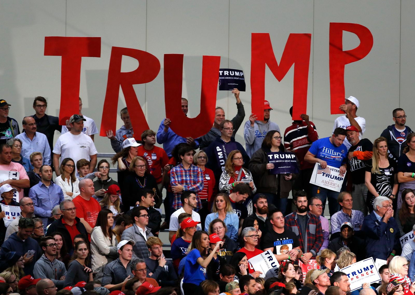 FILE - In this Nov. 8, 2016 file photo, supporters hold signs for Republican presidential candidate Donald Trump during a rally, in Grand Rapids, Michigan. (AP Photo/Paul Sancya, File)