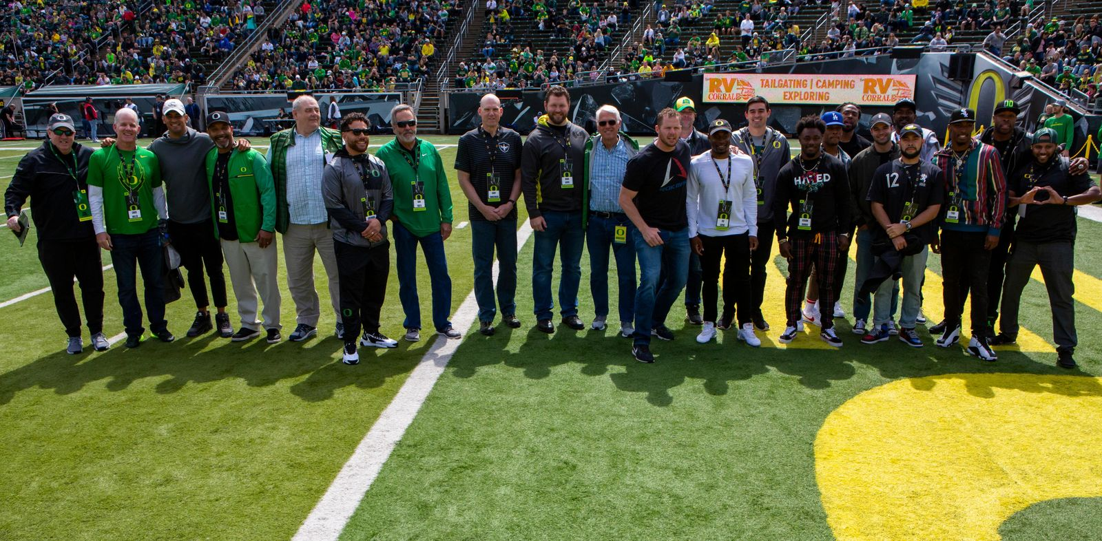 Former Oregon football players pose for a photograph before Saturday's game, Oregon football fans took to Autzen Stadium in Eugene, Ore for the annual spring football game on April 20, 2019. [Ben Lonergan for KVAL.com] - KVAL.com