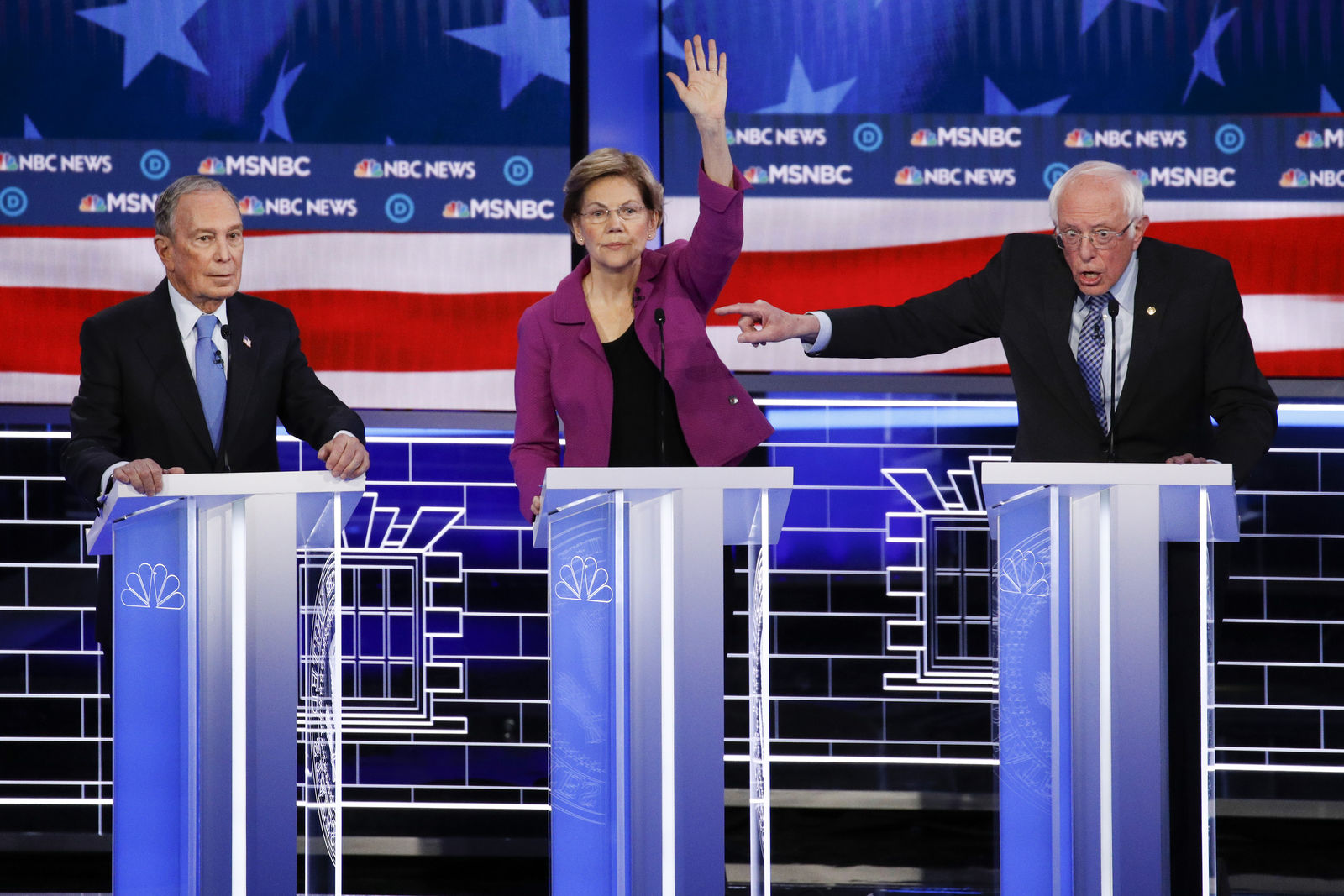 From left, Democratic presidential candidates, former New York City Mayor Mike Bloomberg, Sen. Elizabeth Warren, D-Mass., Sen. Bernie Sanders, I-Vt., participate in a Democratic presidential primary debate Wednesday, Feb. 19, 2020, in Las Vegas, hosted by NBC News and MSNBC. (AP Photo/John Locher)