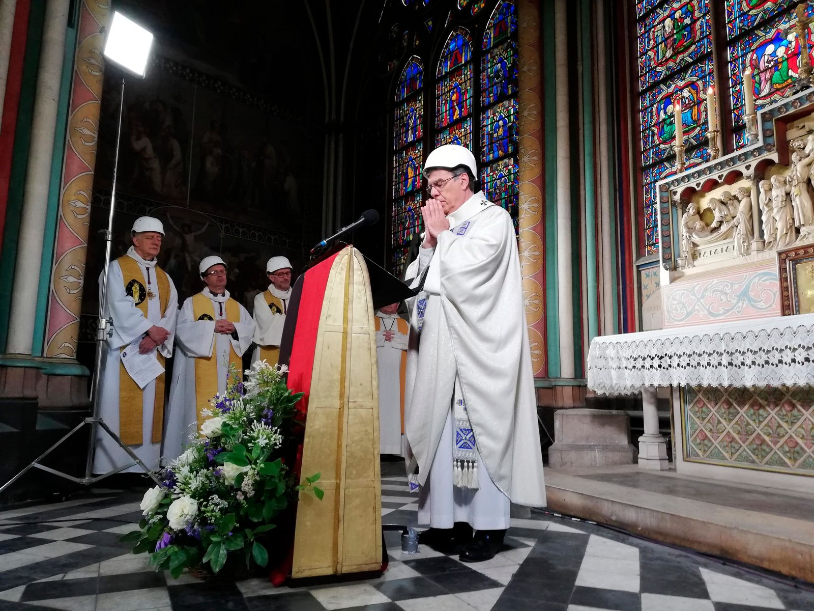 The Archbishop of Paris Michel Aupetit leads the first mass in a side chapel, two months after a devastating fire engulfed the Notre-Dame de Paris cathedral, Saturday June 15, 2019, in Paris. (Karine Perret, Pool via AP)