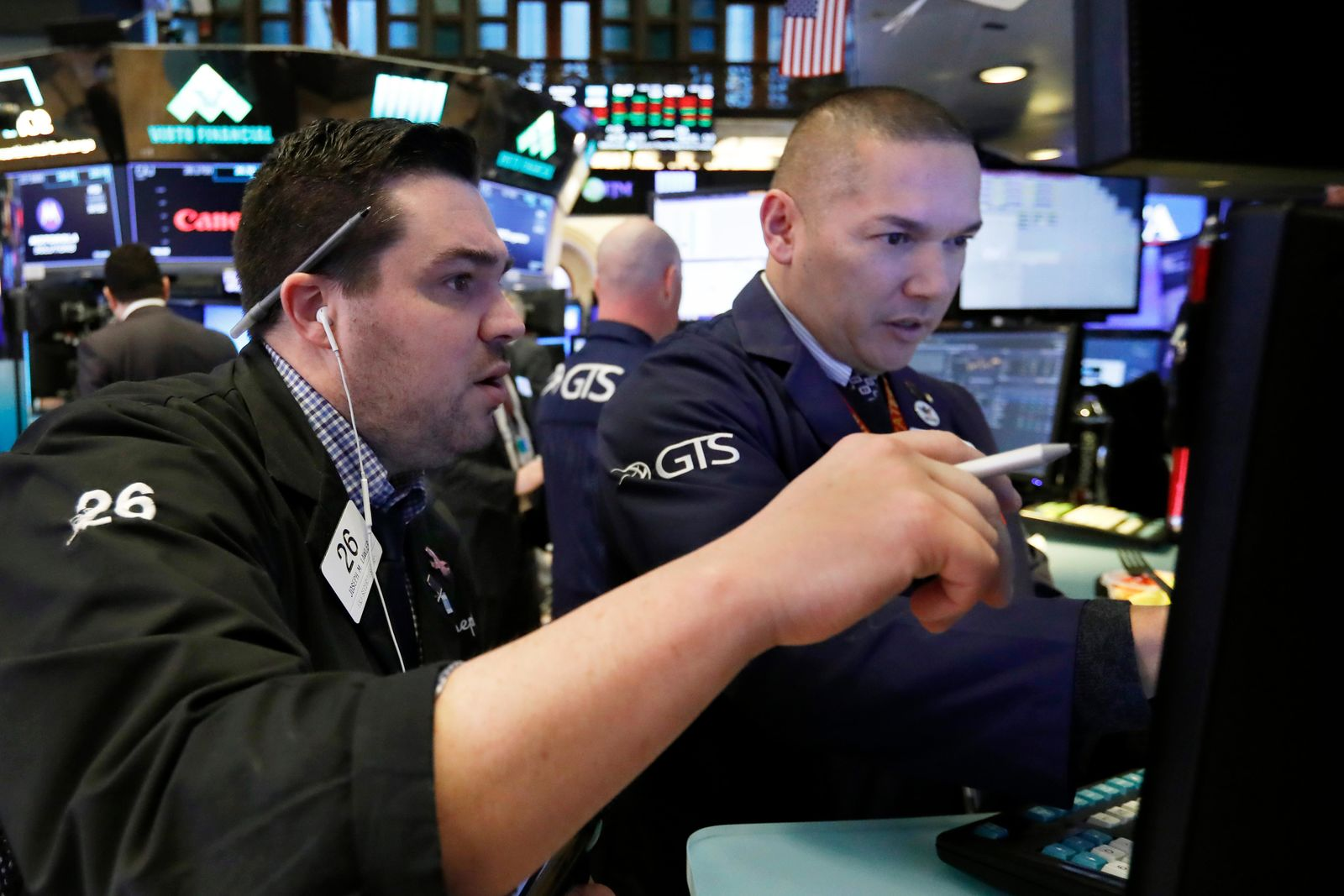 FILE - Trader Joseph Lawler, left, and specialist Mark Otto work on the floor of the New York Stock Exchange, Friday, Jan. 11, 2019. (AP Photo/Richard Drew)