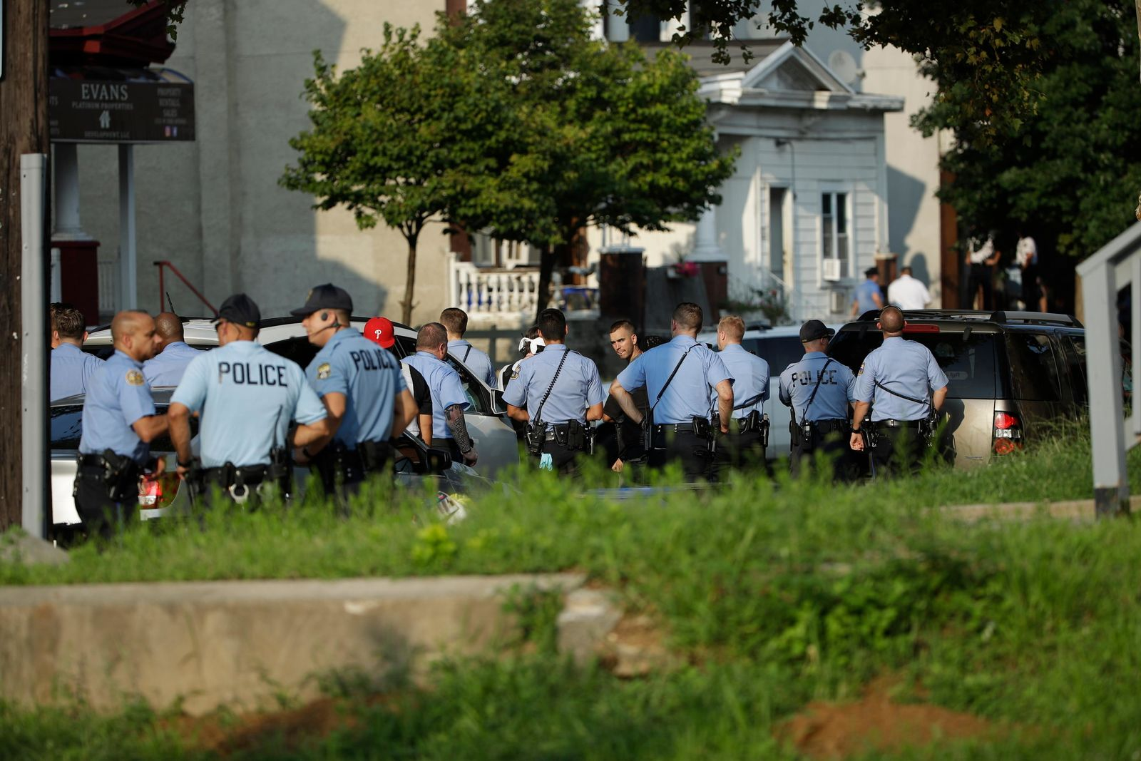 Authorities stage as they respond to an active shooting situation, Wednesday, Aug. 14, 2019, in the Nicetown neighborhood of Philadelphia. (AP Photo/Matt Rourke)